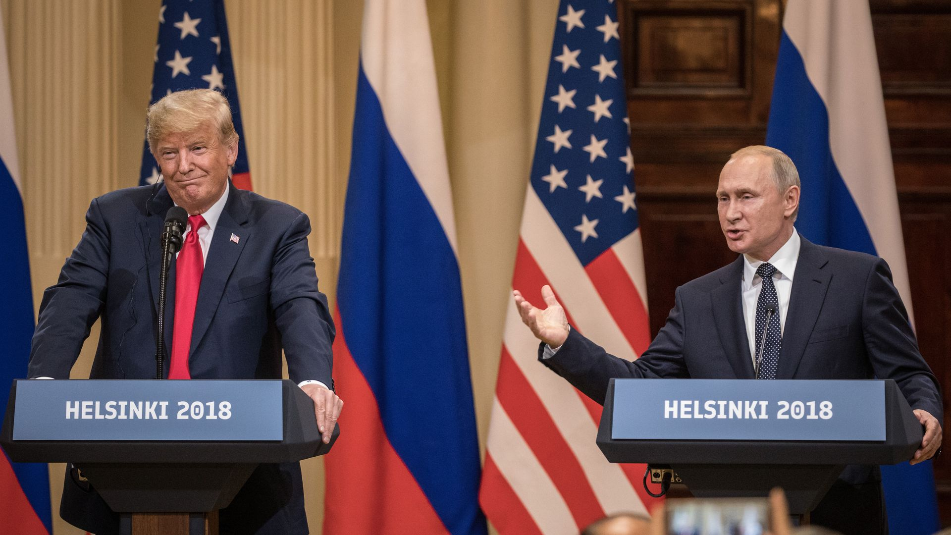 Trump and Putin in Helsinki at podiums speaking.