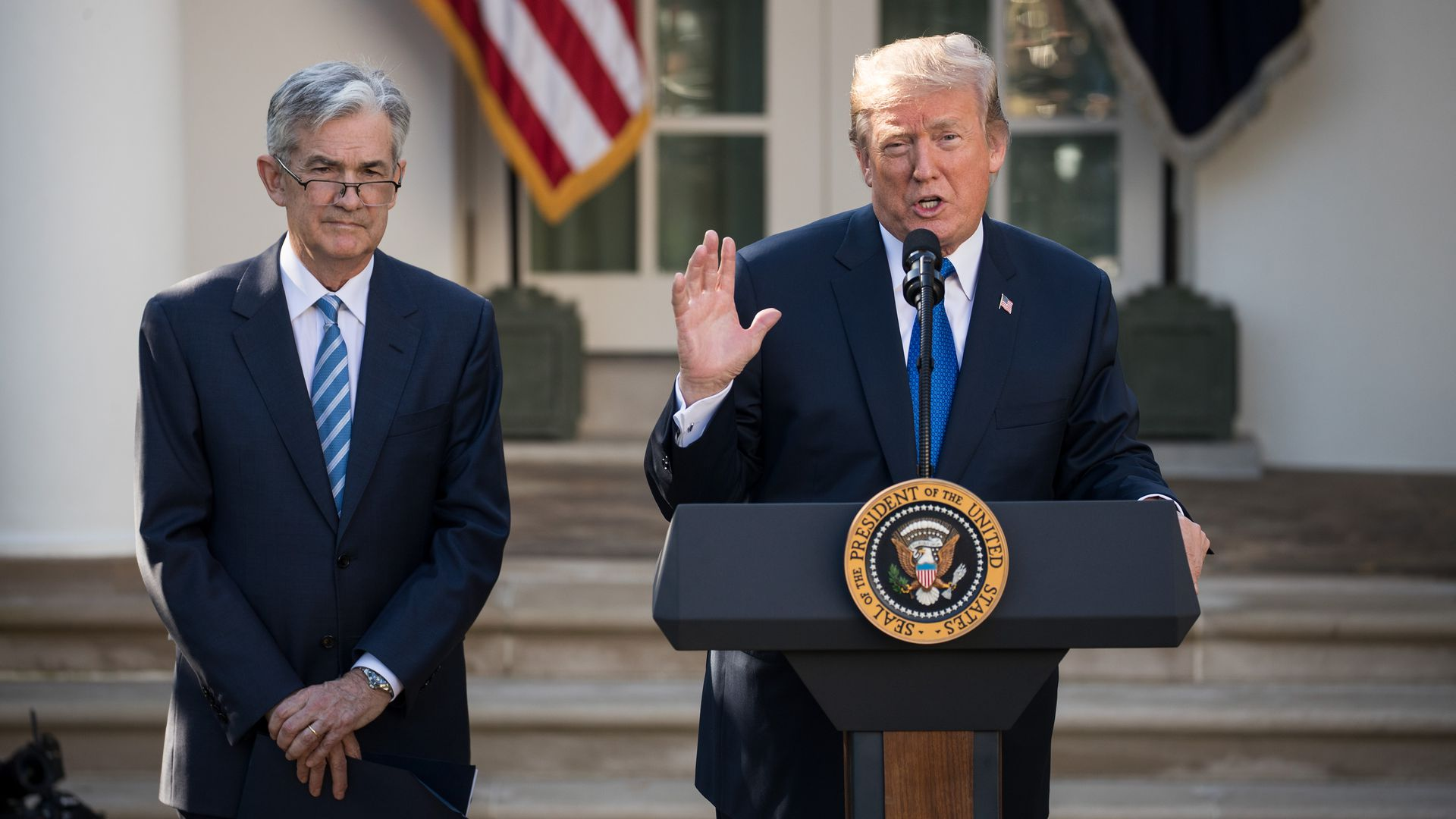 President Trump stands with Federal Reserve chairman Jerome Powell in front of the White House