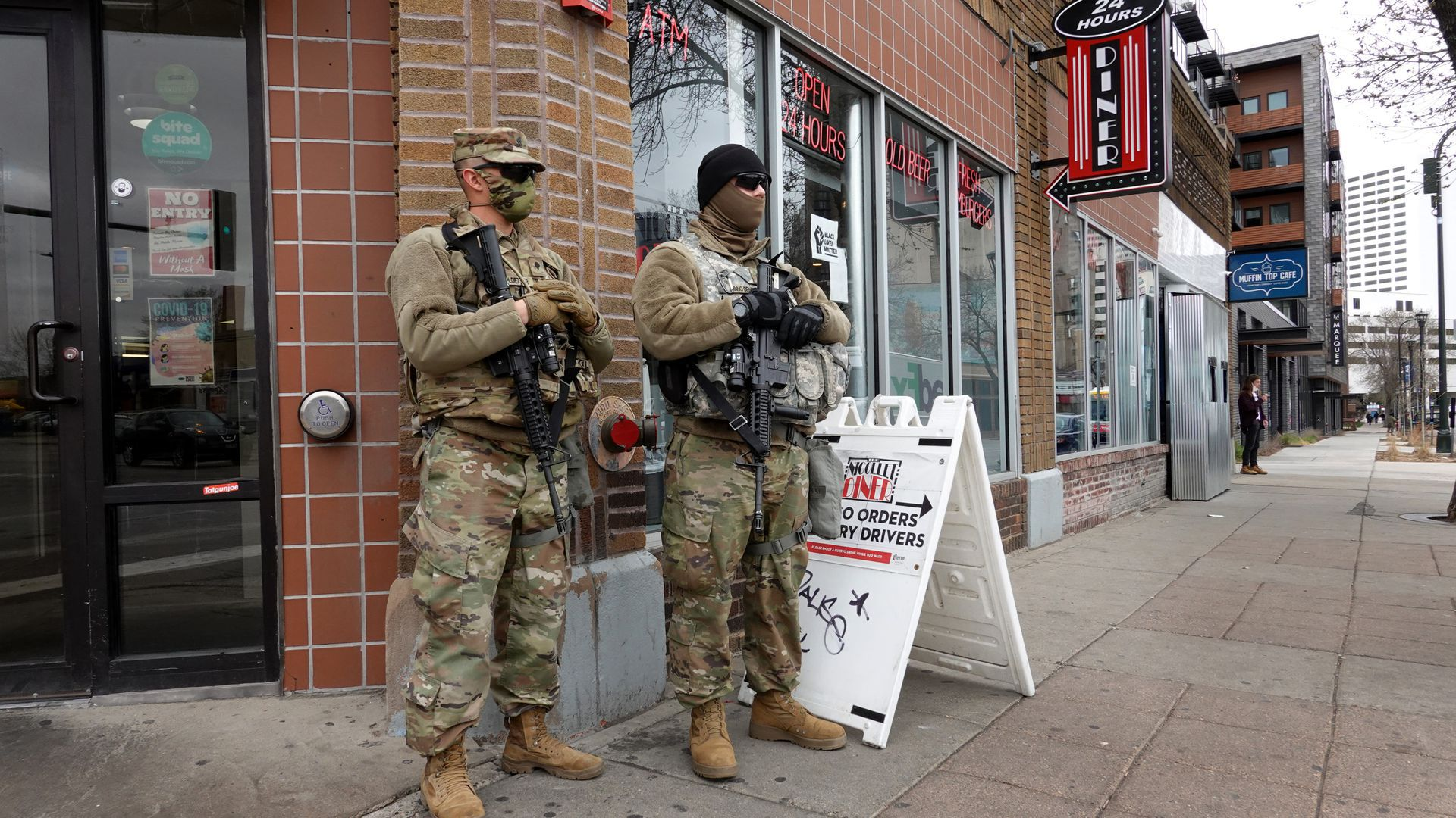 National guard members stand outside a building
