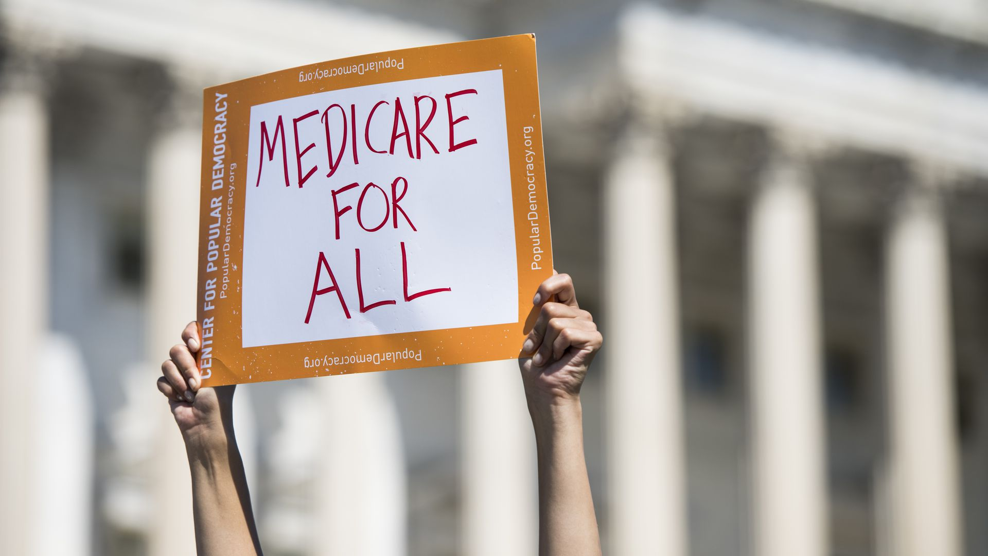 "A sign saying ""Medicare for All"""