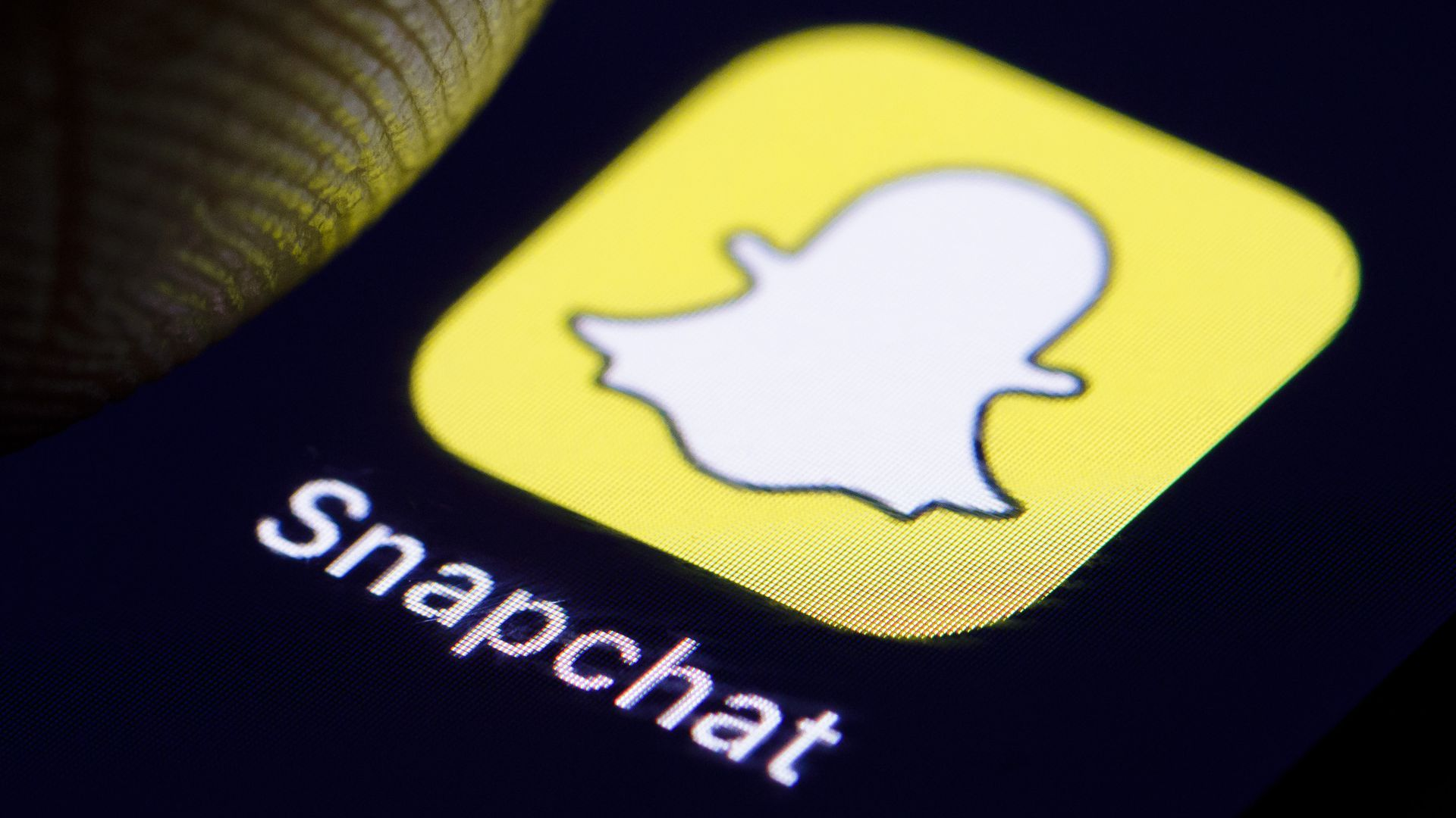 Close-up photo of Snapchat's mobile app icon on a smartphone.