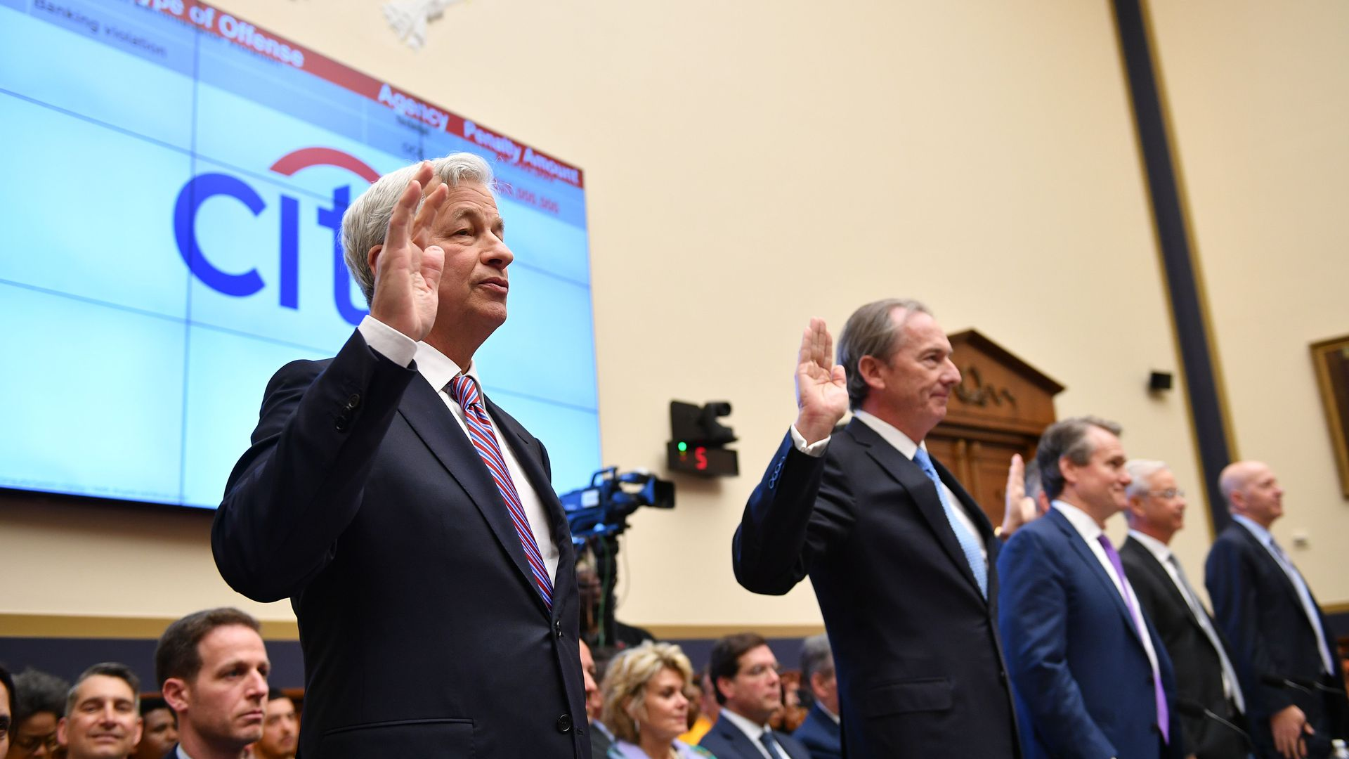 JP Morgan CEO James Dimon(L) and others are sworn in before they testify before the House Financial Services Committee