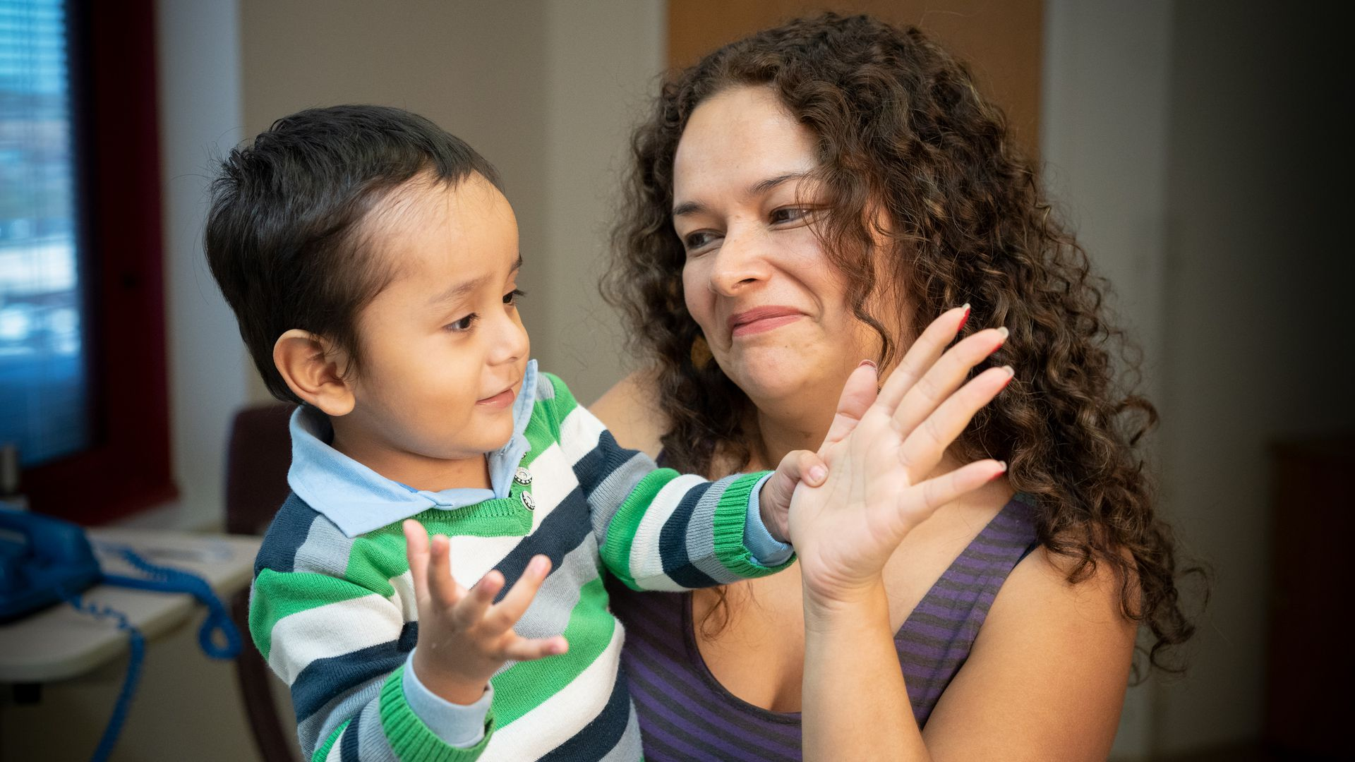 Photo of 2-year-old boy, Gael, who is playing with his Mom after receiving therapy for SCID