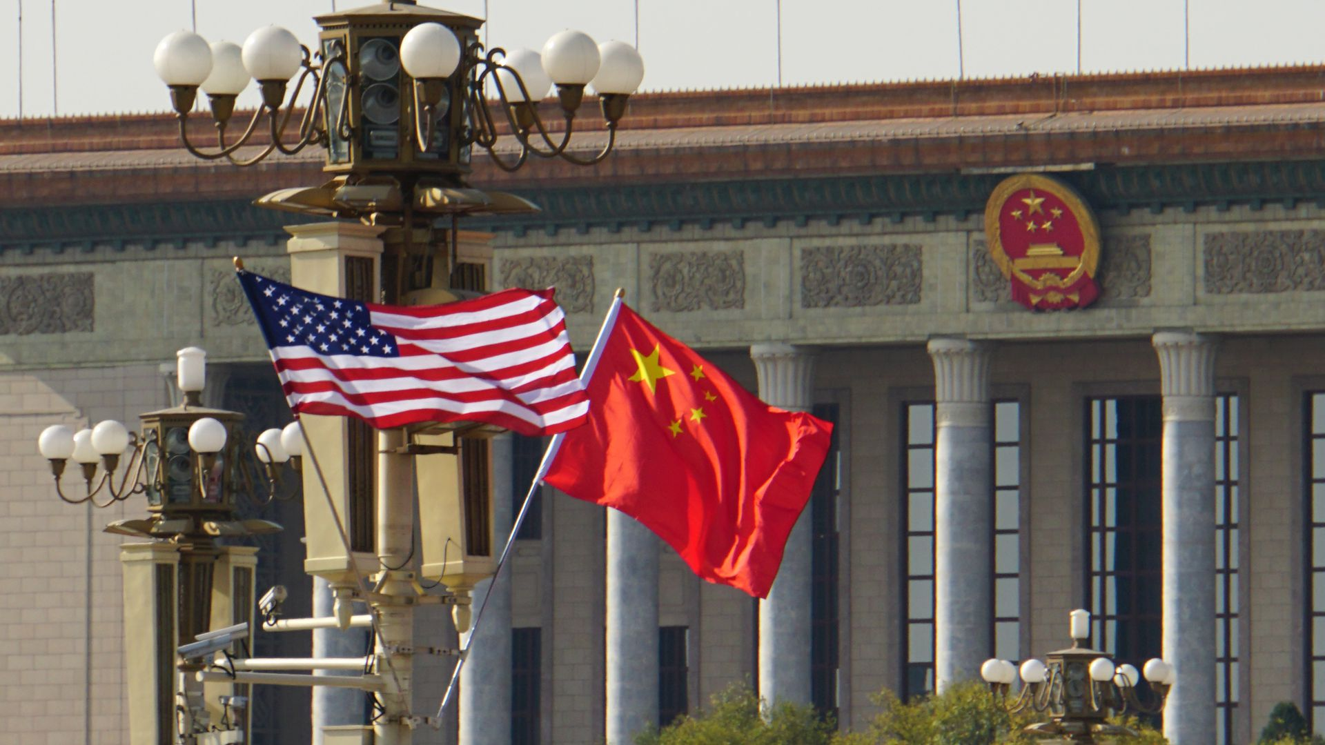U.S. and Chinese flags flying together in Beijing in November before tensions ratcheted up