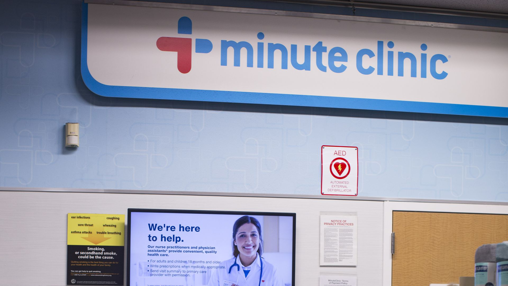 A woman waits outside of a CVS MinuteClinic.