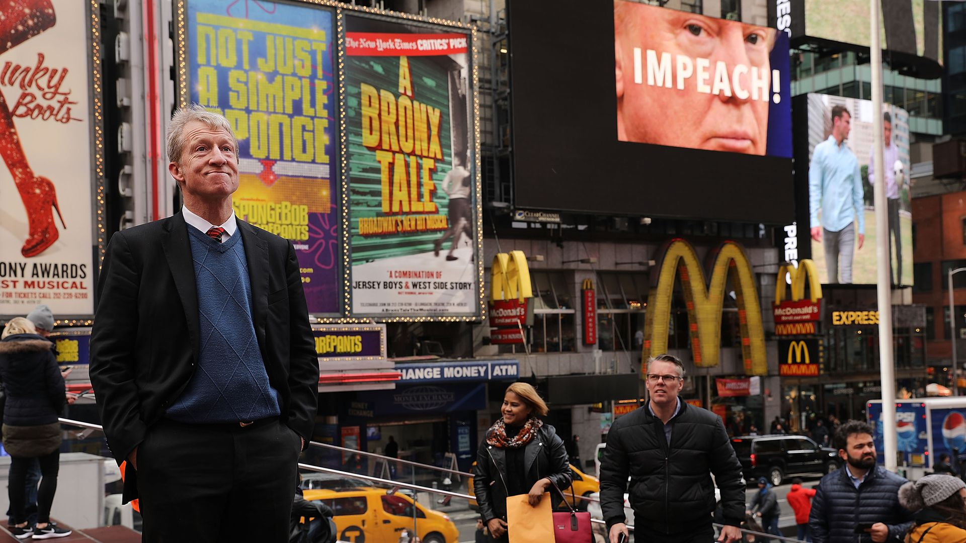 Tom Steyer standing in the middle of Times Square in New York
