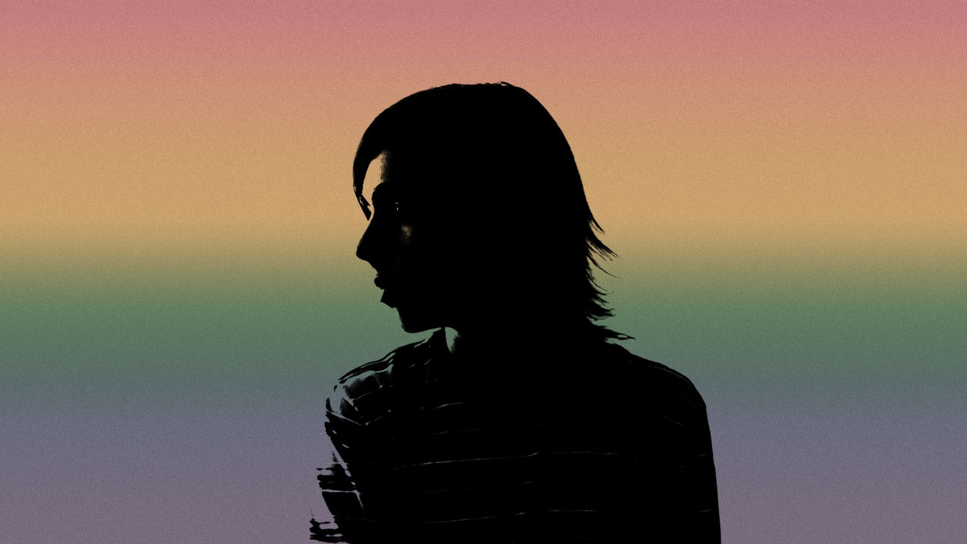 Illustration of the colors of the LGBTQ Pride flag projected over the silhouette of a teenager.