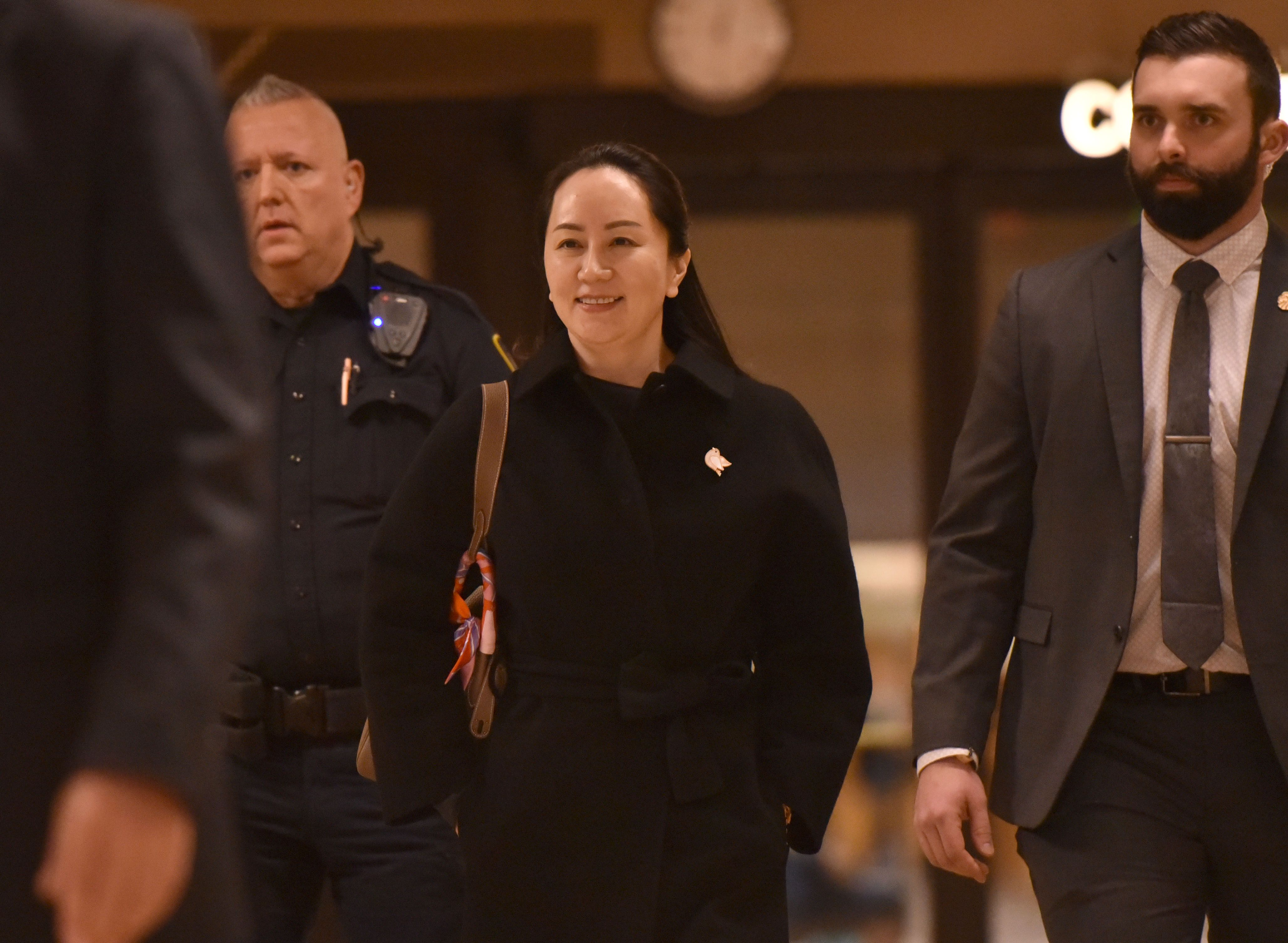 Justice Department slaps Huawei with new racketeering charges - Axios