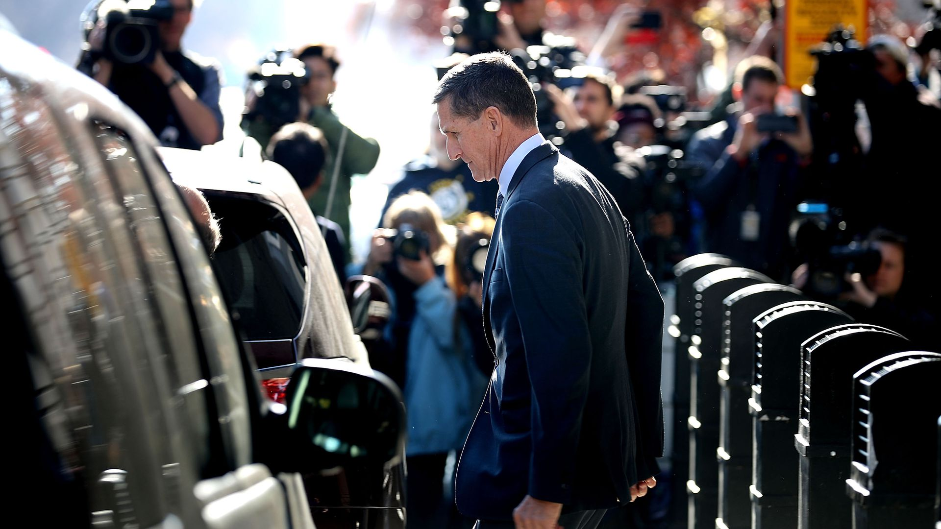 Michael Flynn leaves following his plea hearing in December.