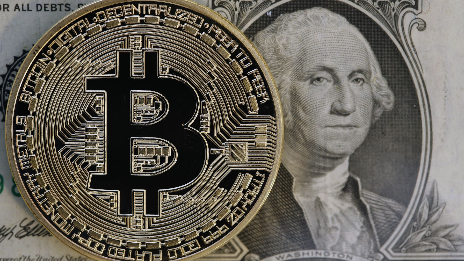 Bitcoin and a dollar bill