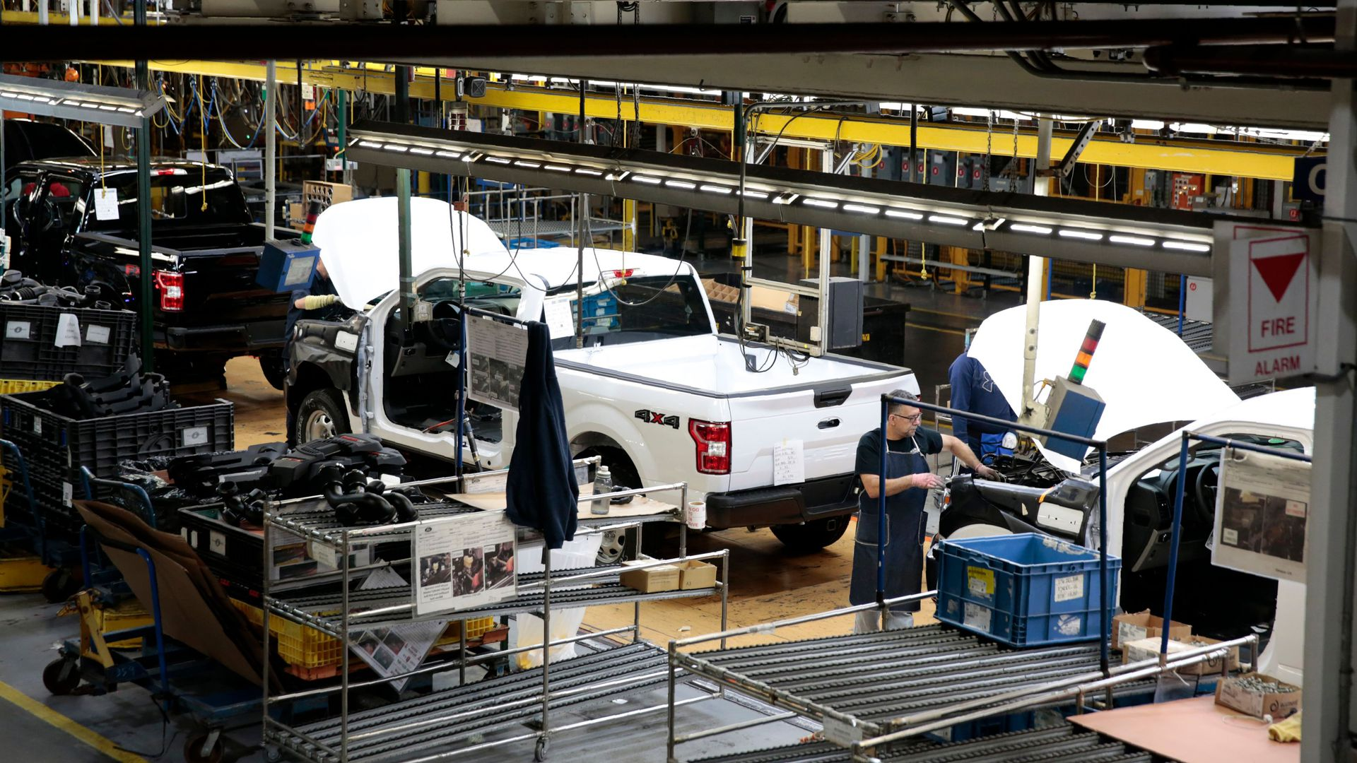 ford trucks on an assembly line in a manufacturing plant