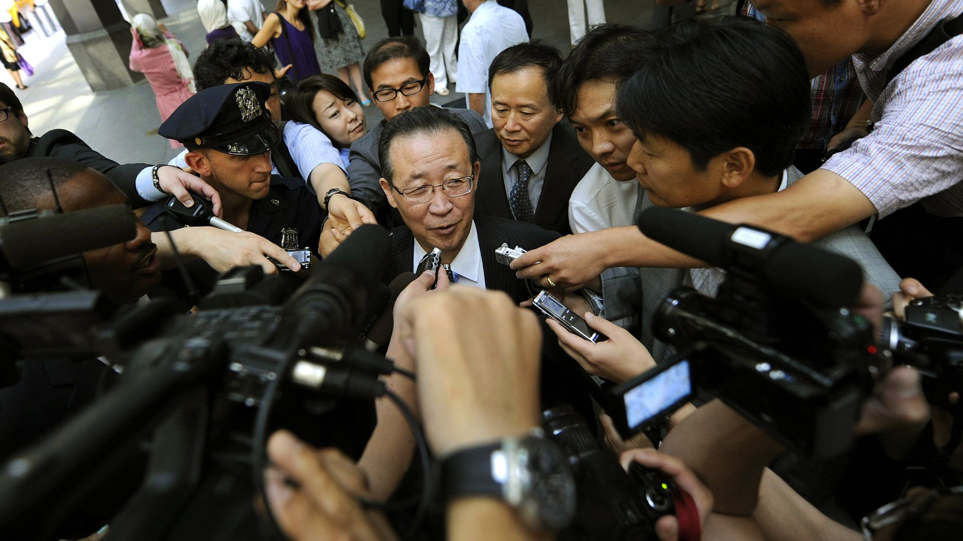 North Korean Vice Foreign Minister Kim Kye Gwan surrounded by media.