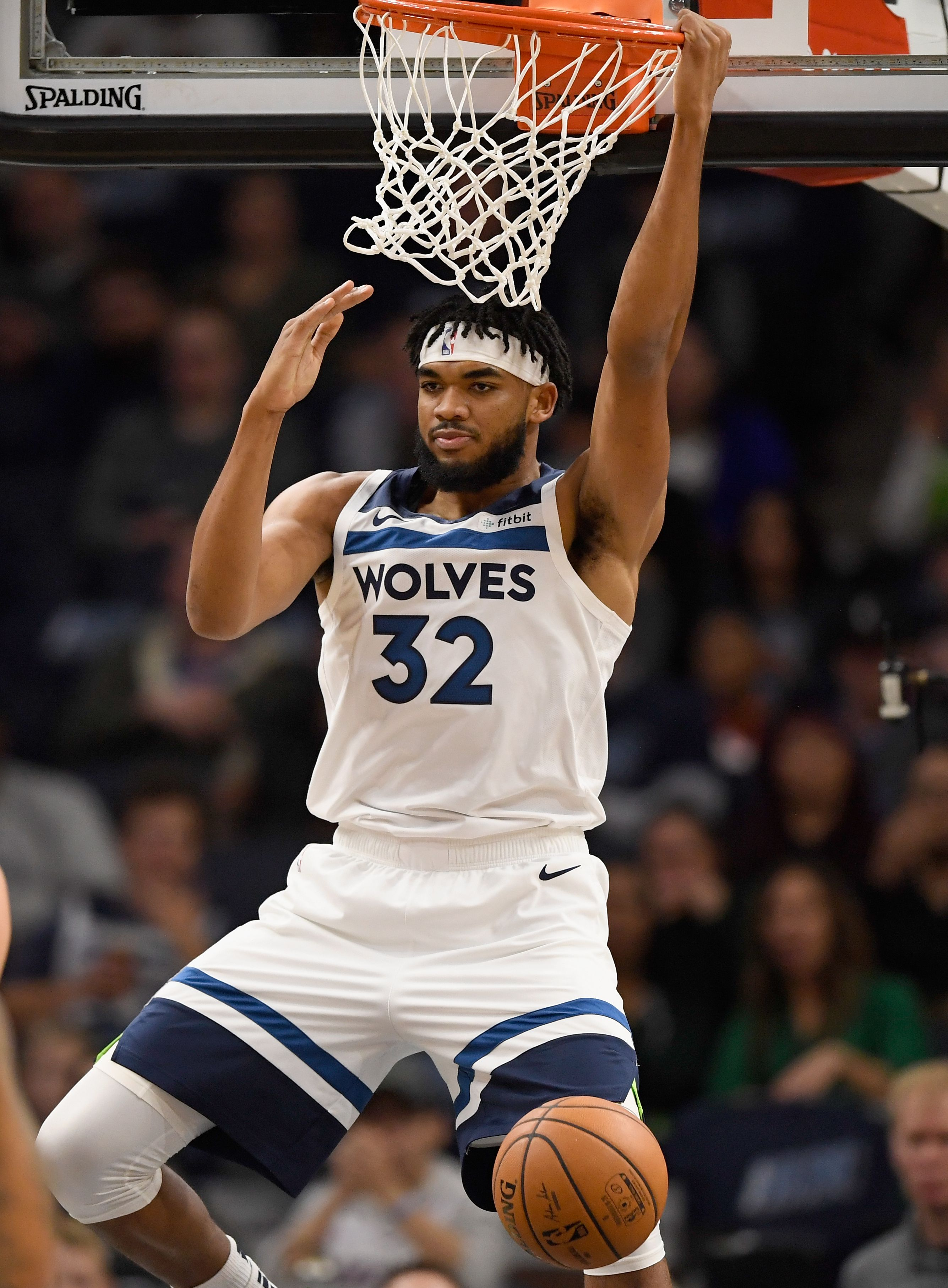 Karl-Anthony Towns hanging on the rim