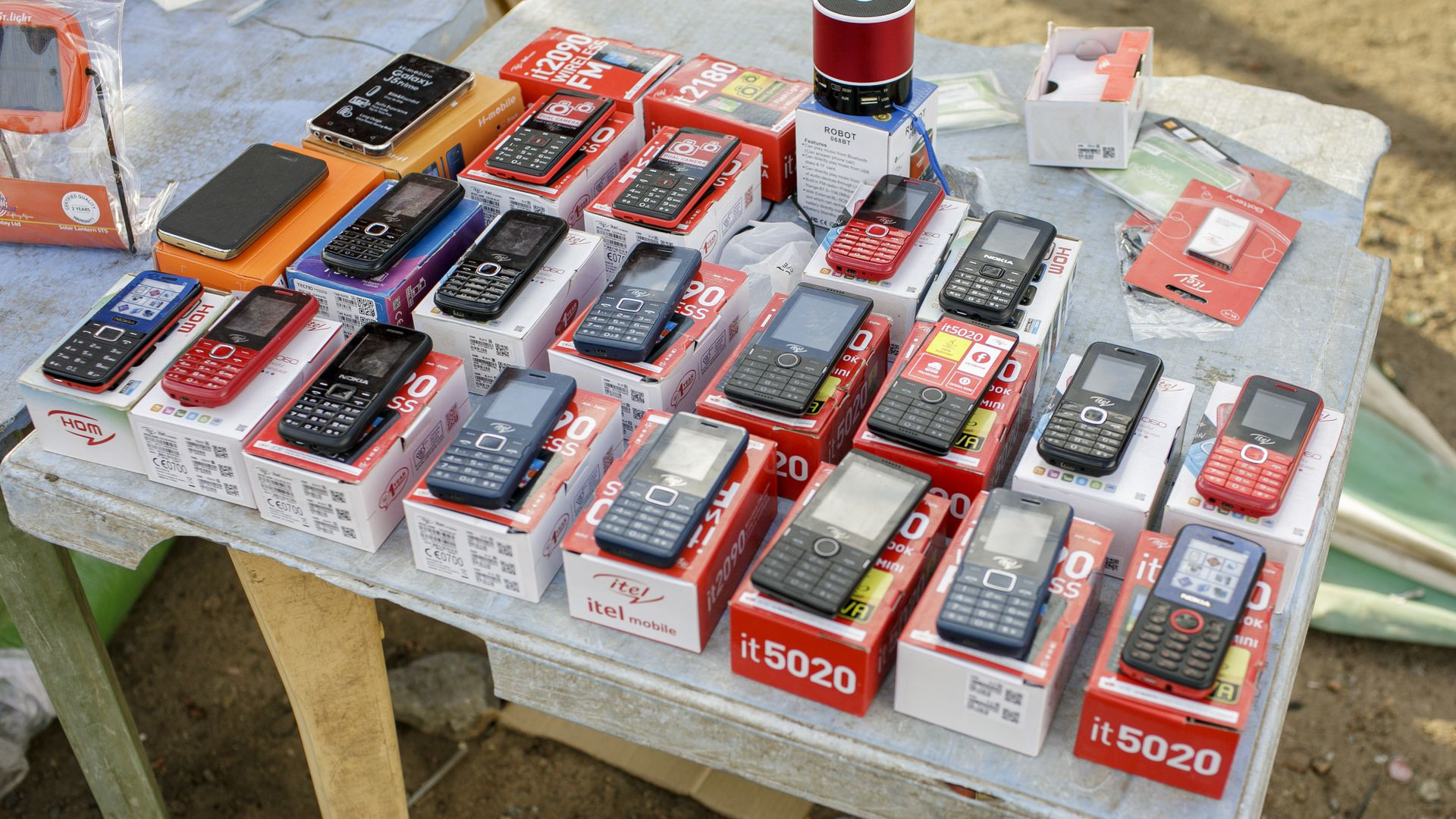Cell phones placed on a table, street trade in Talek on May 17, 2017 in Talek, Kenya.