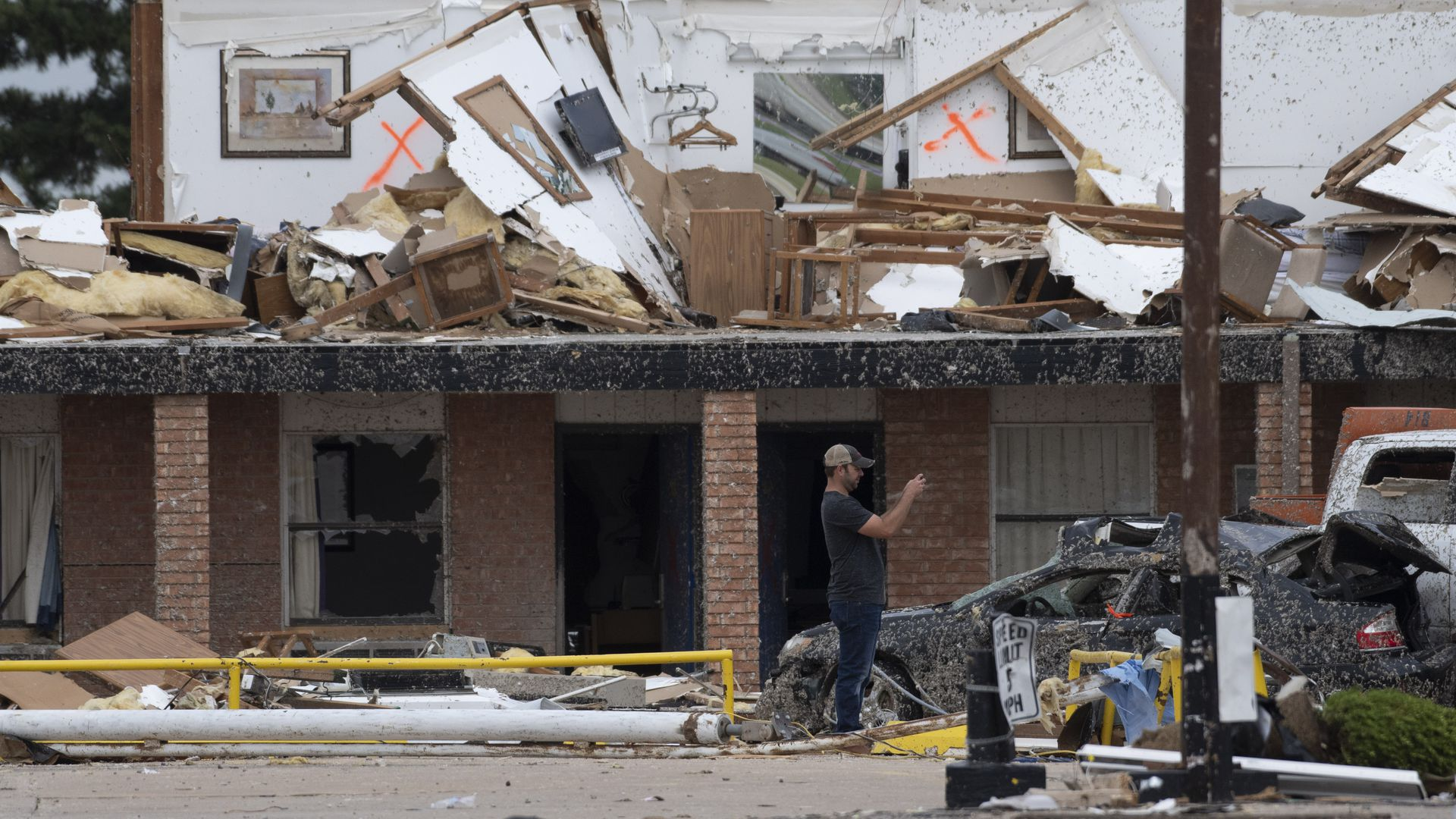 A rescue worker takes photos of the American Value Budget Inn May 26, 2019 in El Reno, Oklahoma.
