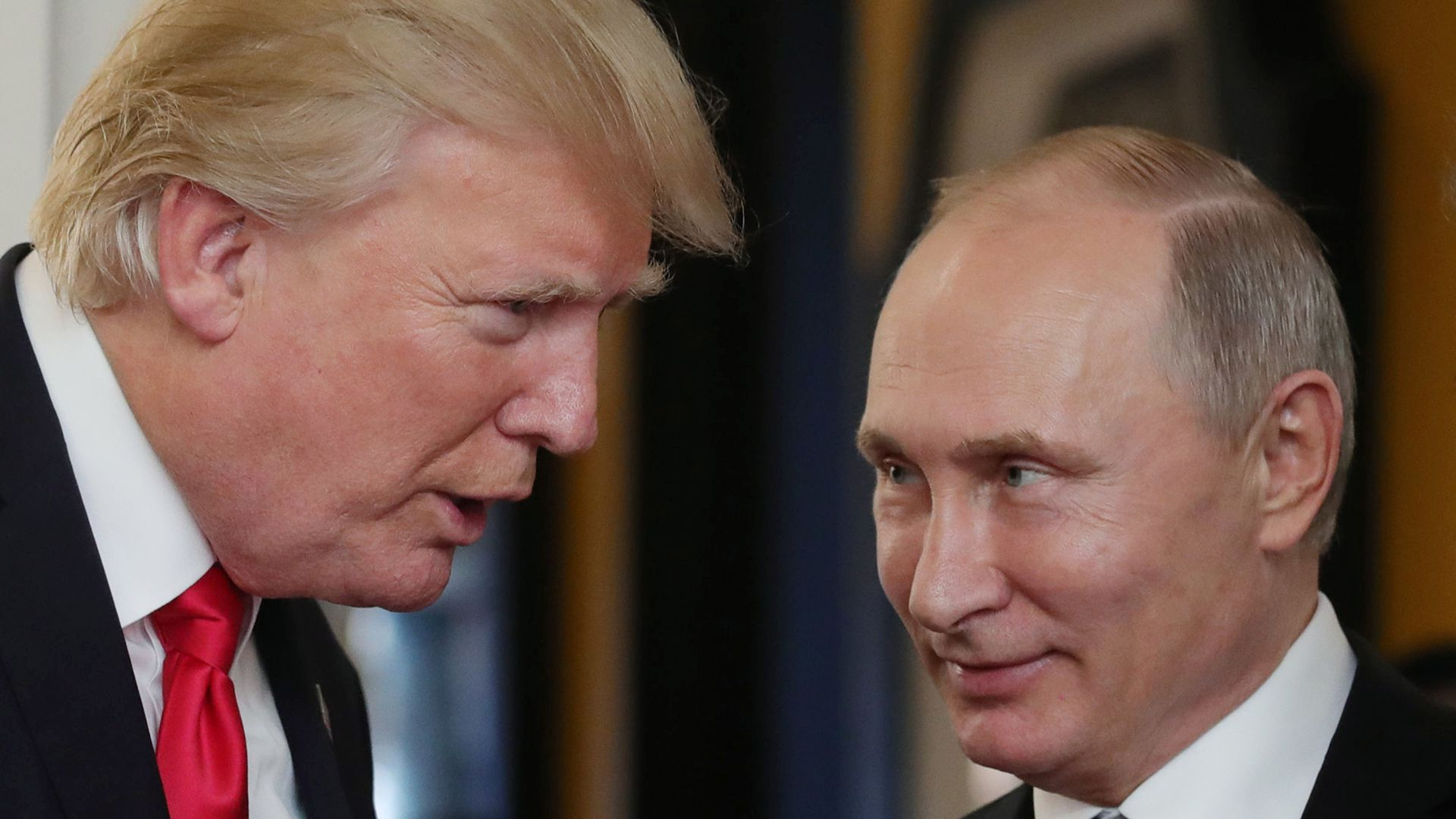 Trump and Putin facing each other in conversation