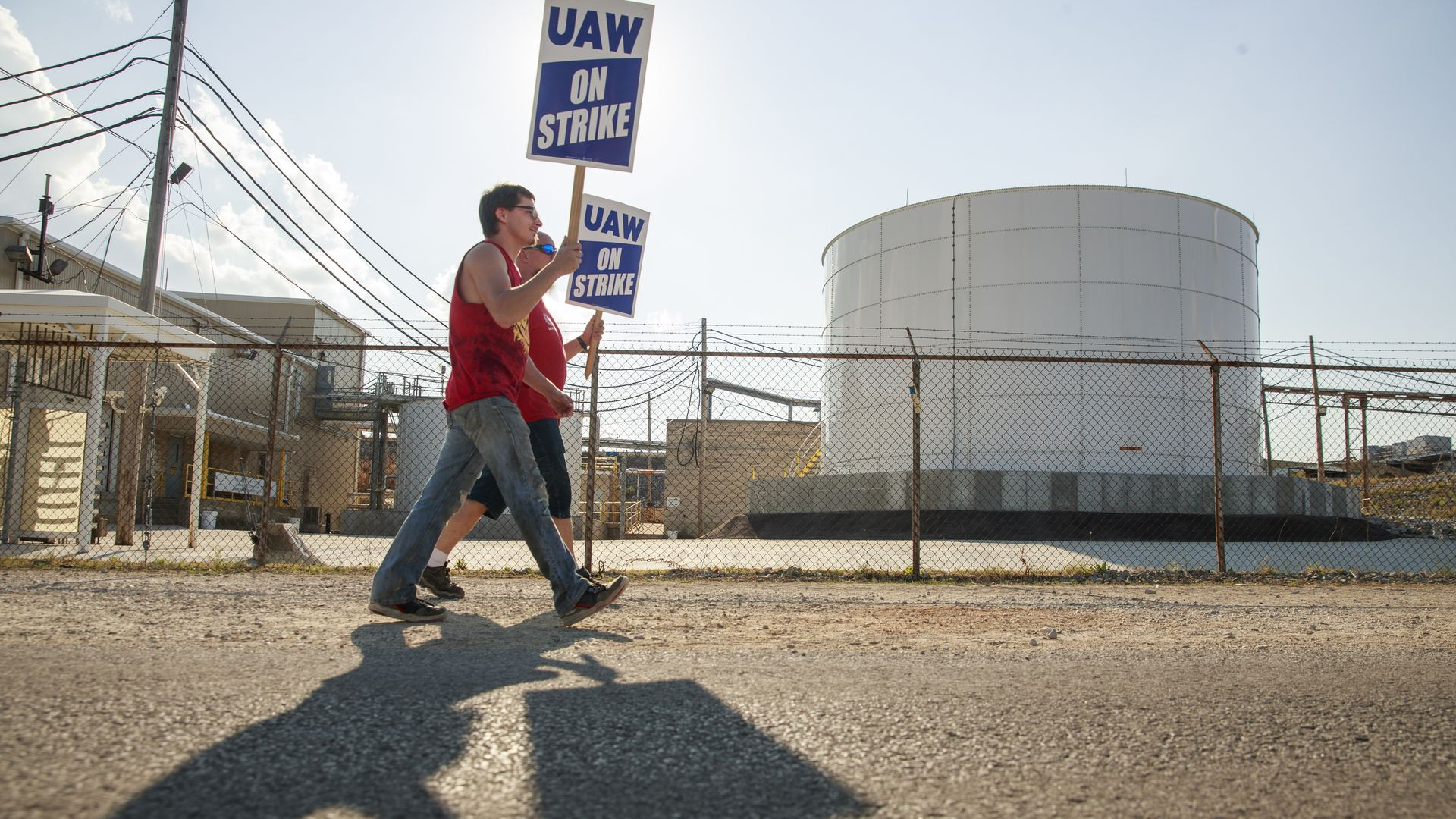 Workers from United Auto Workers picket during national labor strike against GM.