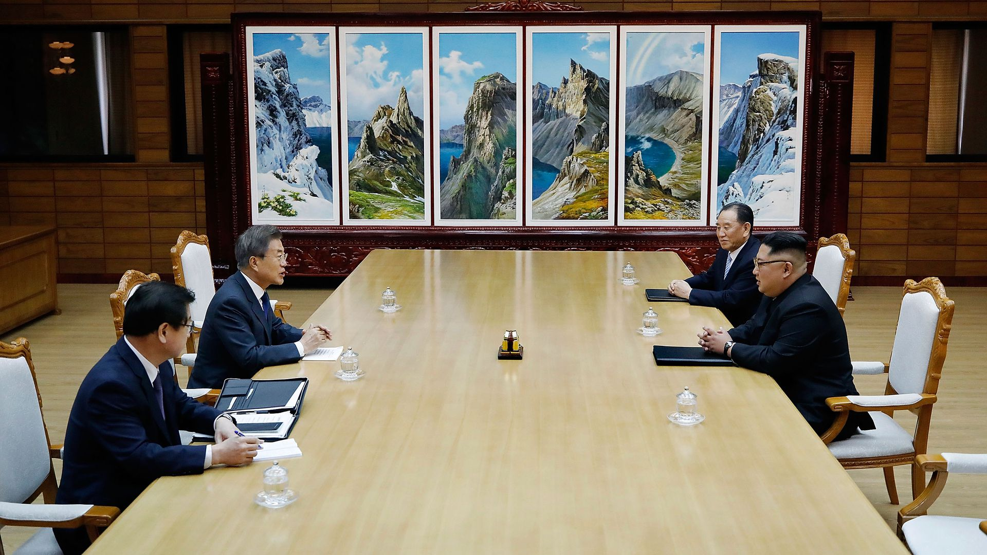 South Korean President Moon Jae-in (L) talks with North Korean leader Kim Jong-un (R) during their meeting on May 26, 2018 in Panmunjom, North Korea.