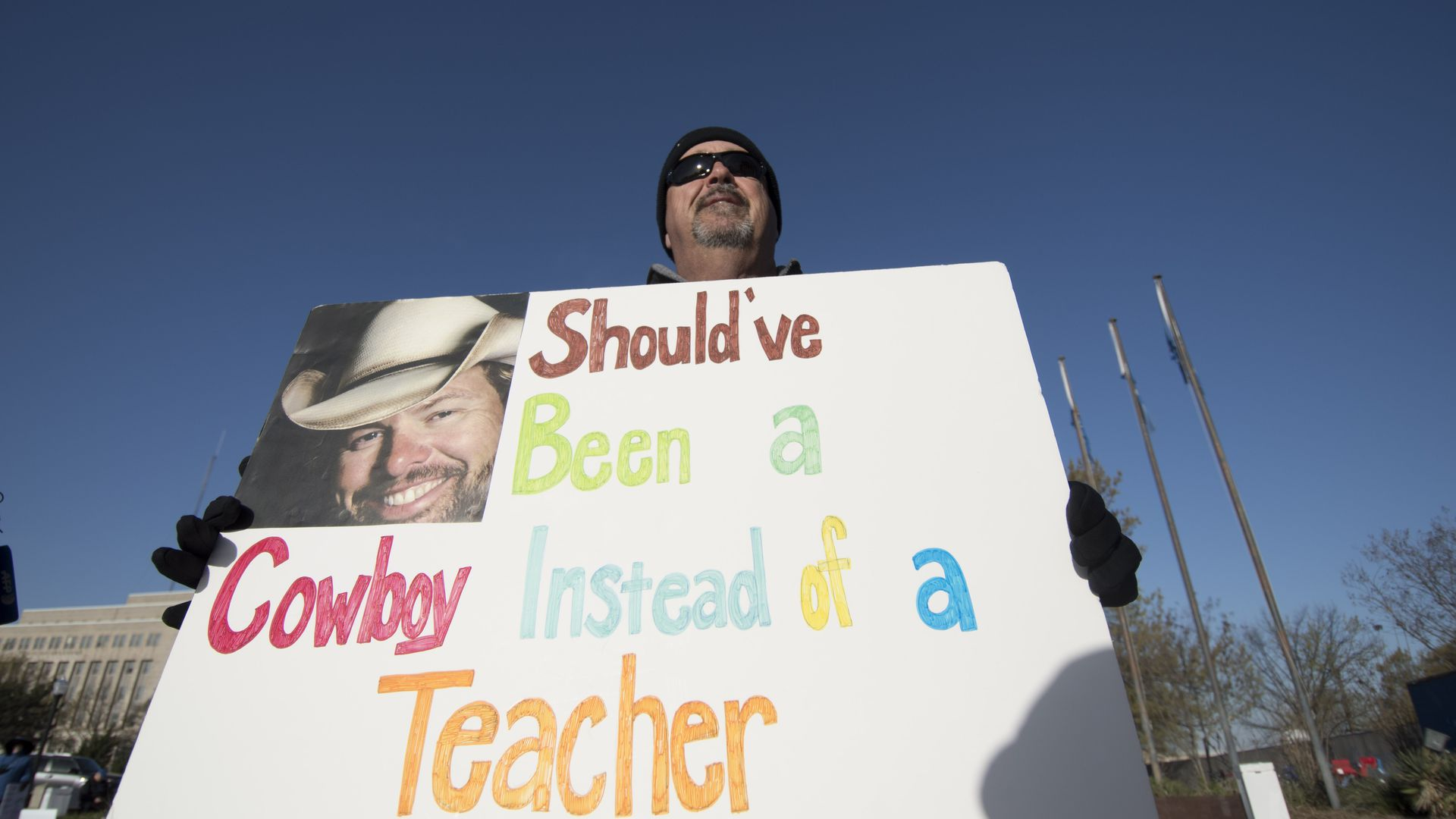 A teacher protesting