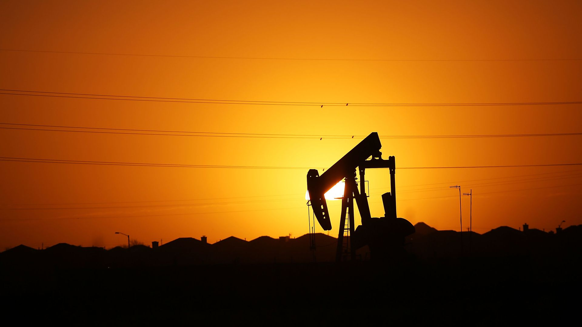 A oil pump in Texas at sunset