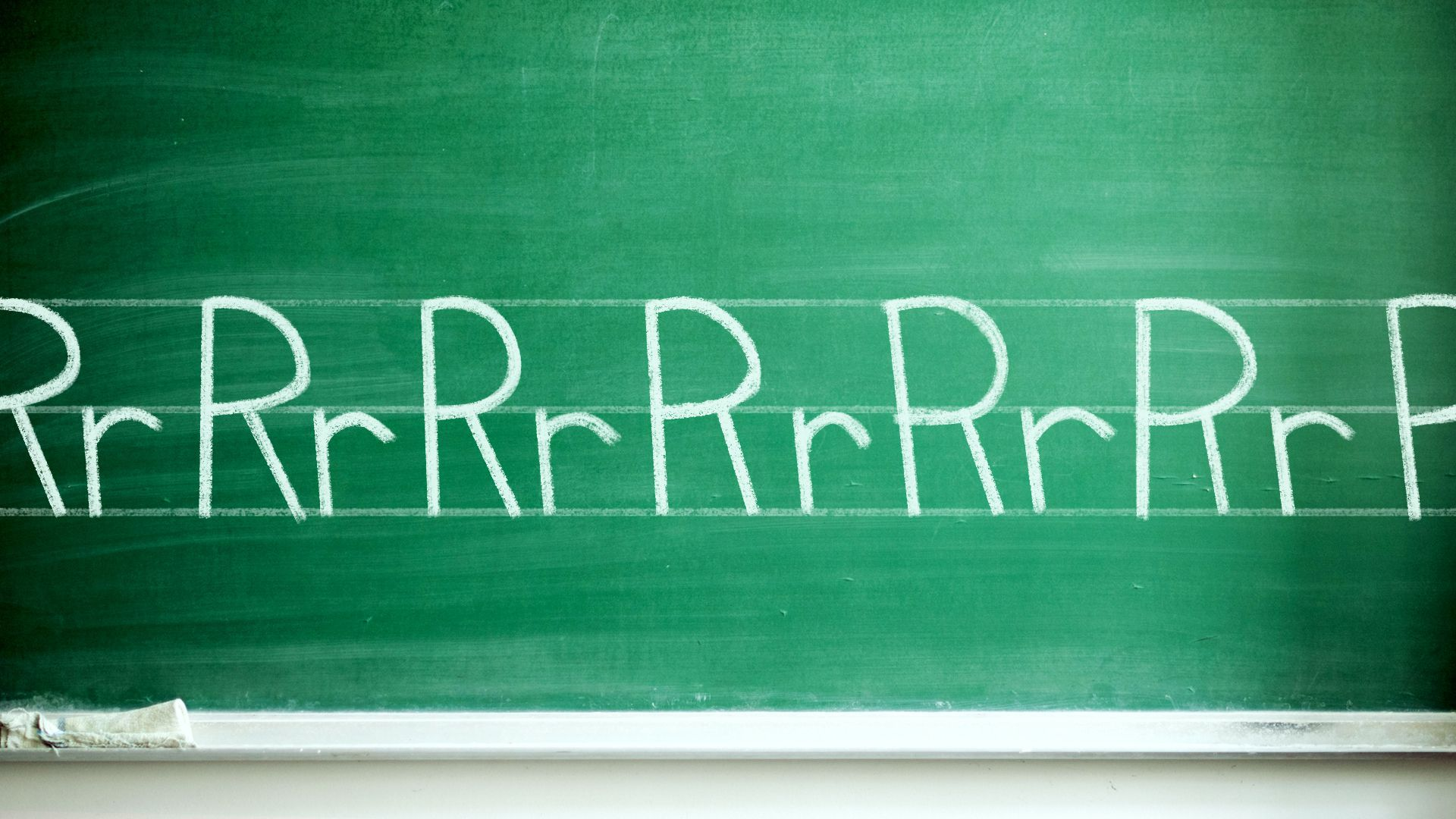 """Illustration of a chalkboard with the alphabet written on it, but every letter is """"R."""""""
