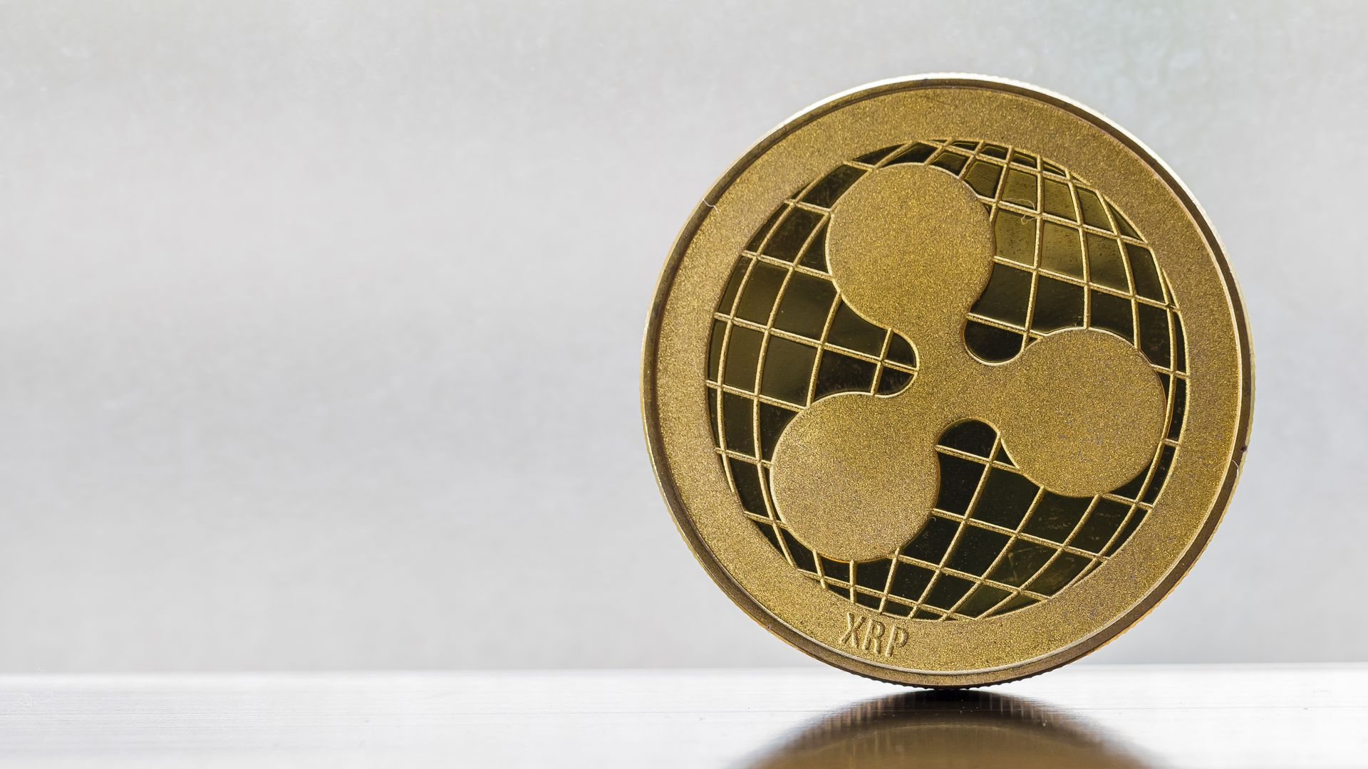 Coin with Ripple's XRP digital currency logo.