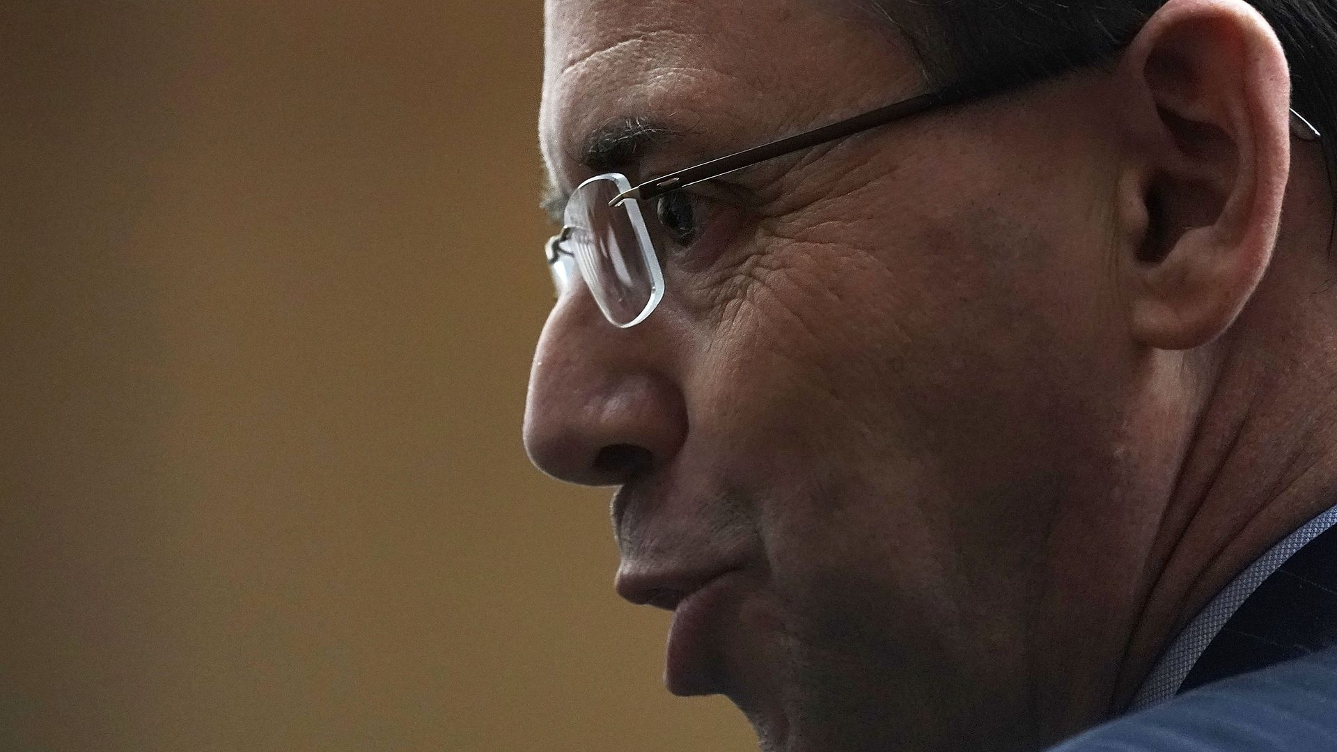 Profile of Rod Rosenstein wearing glasses with his lips puckered