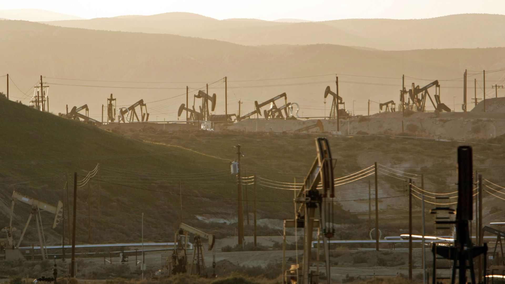 Oil rig pump jacks work the oil fields near the town of Maricopa