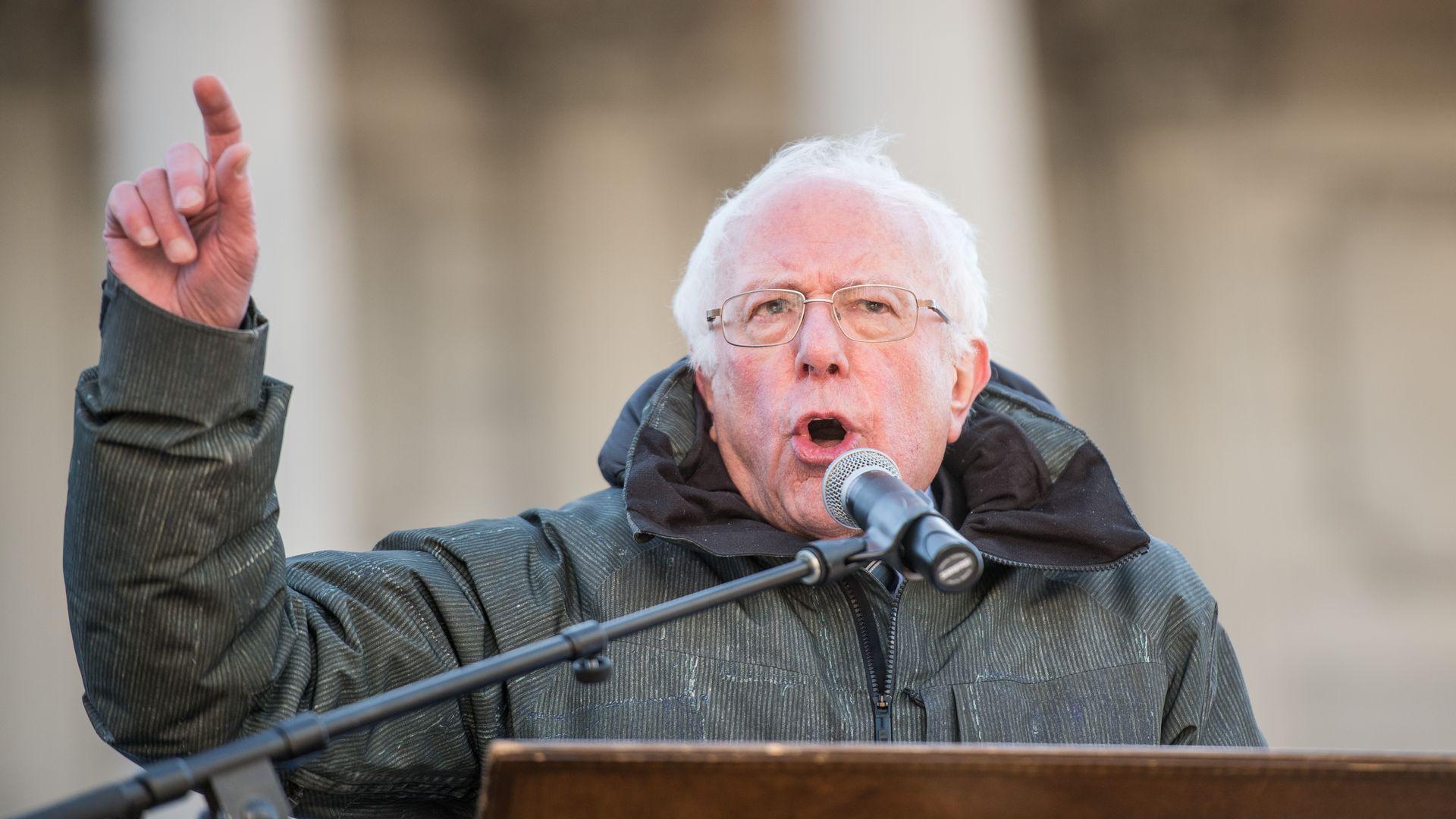 Bernie Sanders speaks at a podium