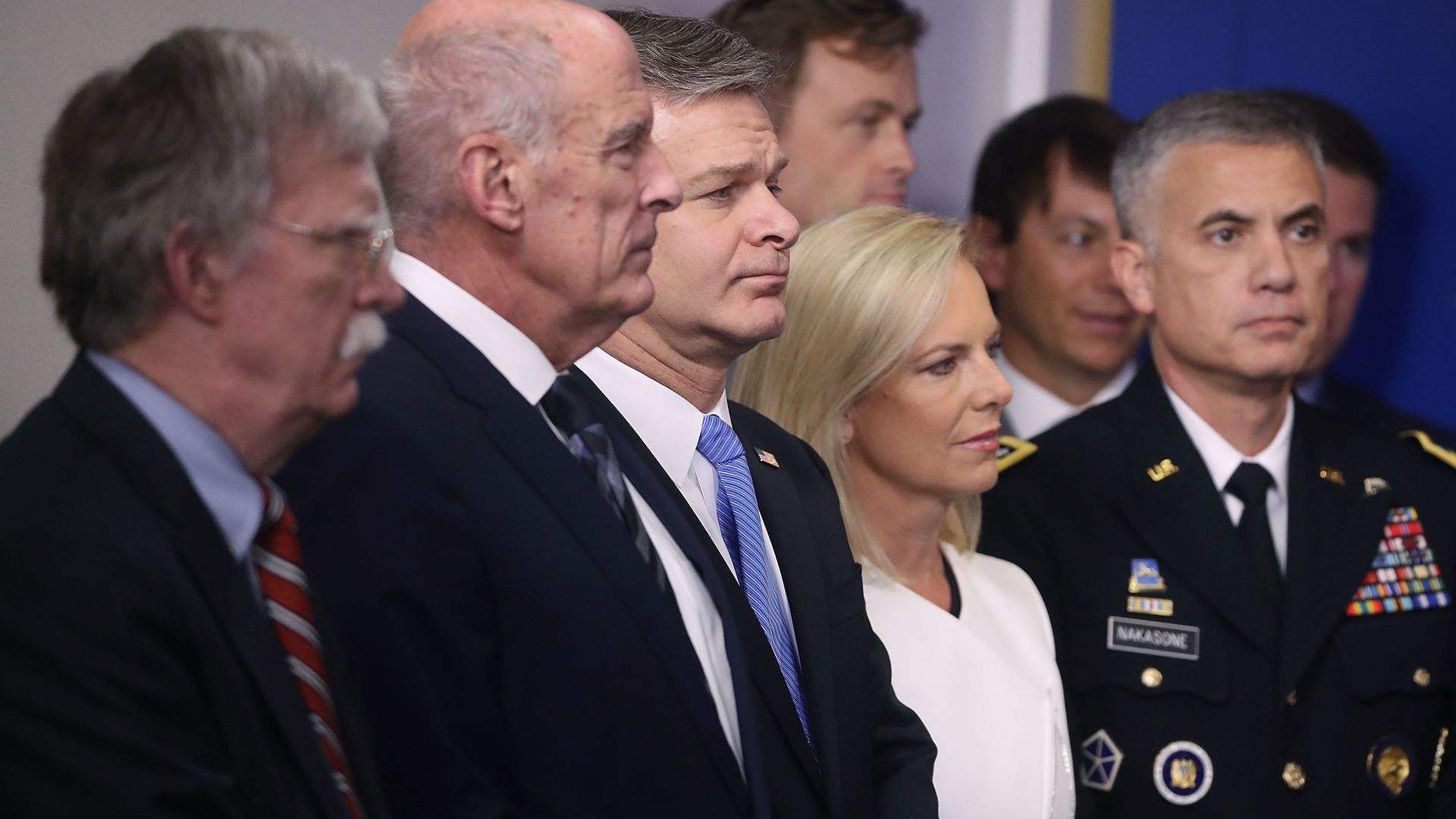 This photo shows top U.S. intelligence officials standing in the White House