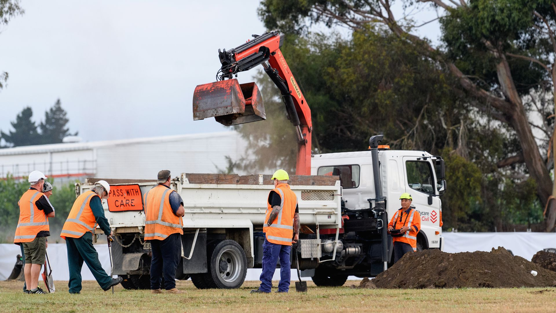 Workers begin digging graves for the victims of the New Zealand mosque attacks.