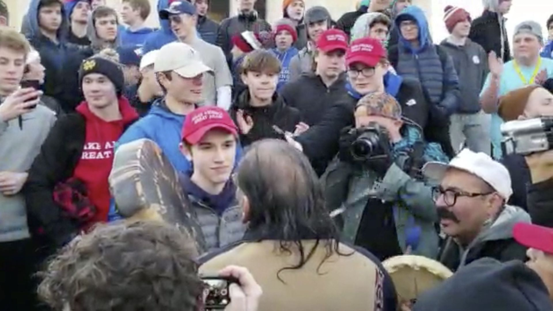 Teenage Trump supporters encounter Native American veterans at Lincoln memorial
