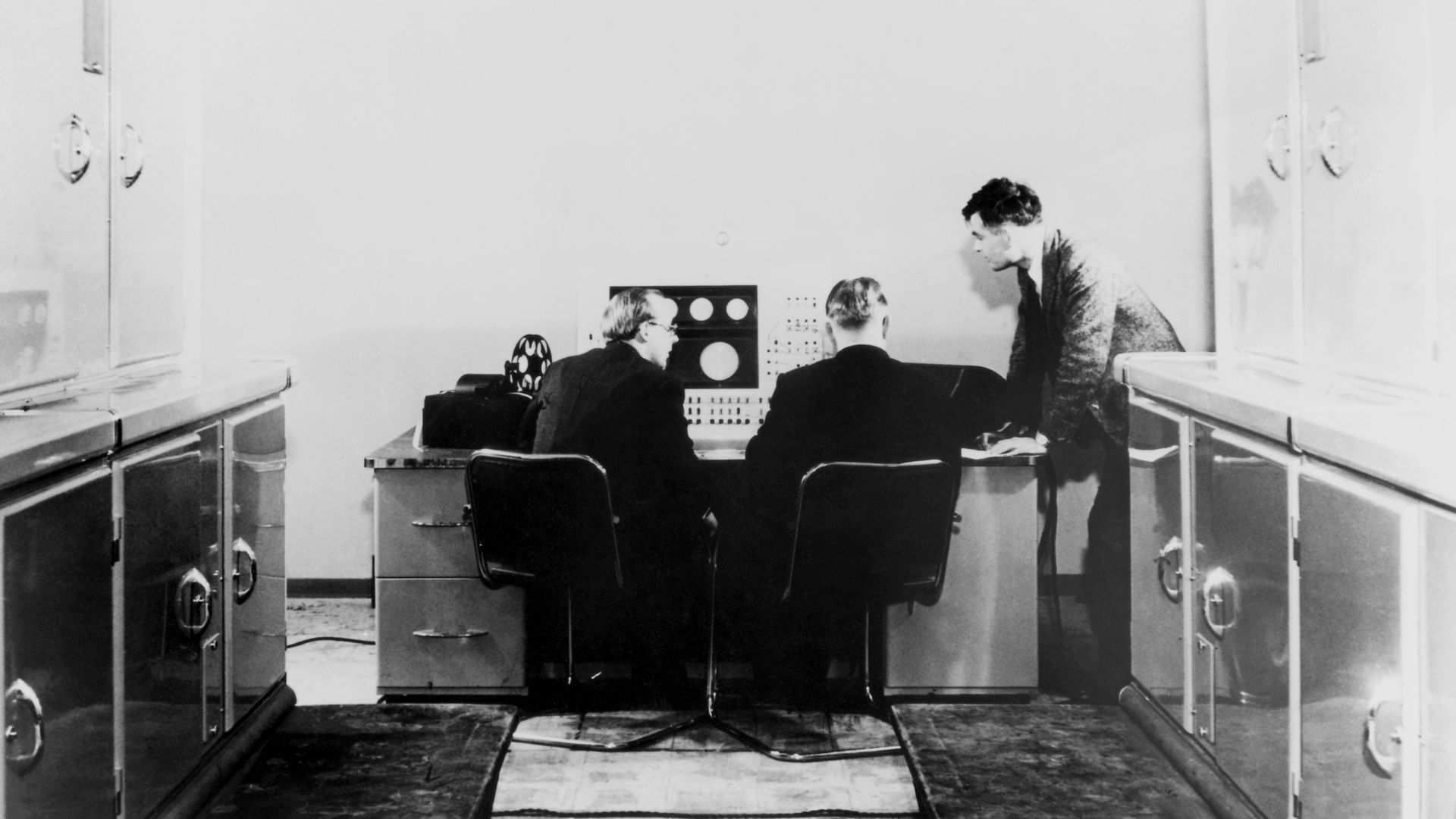 Alan Turing and colleagues working on the Ferranti Mark I Computer, 1951.