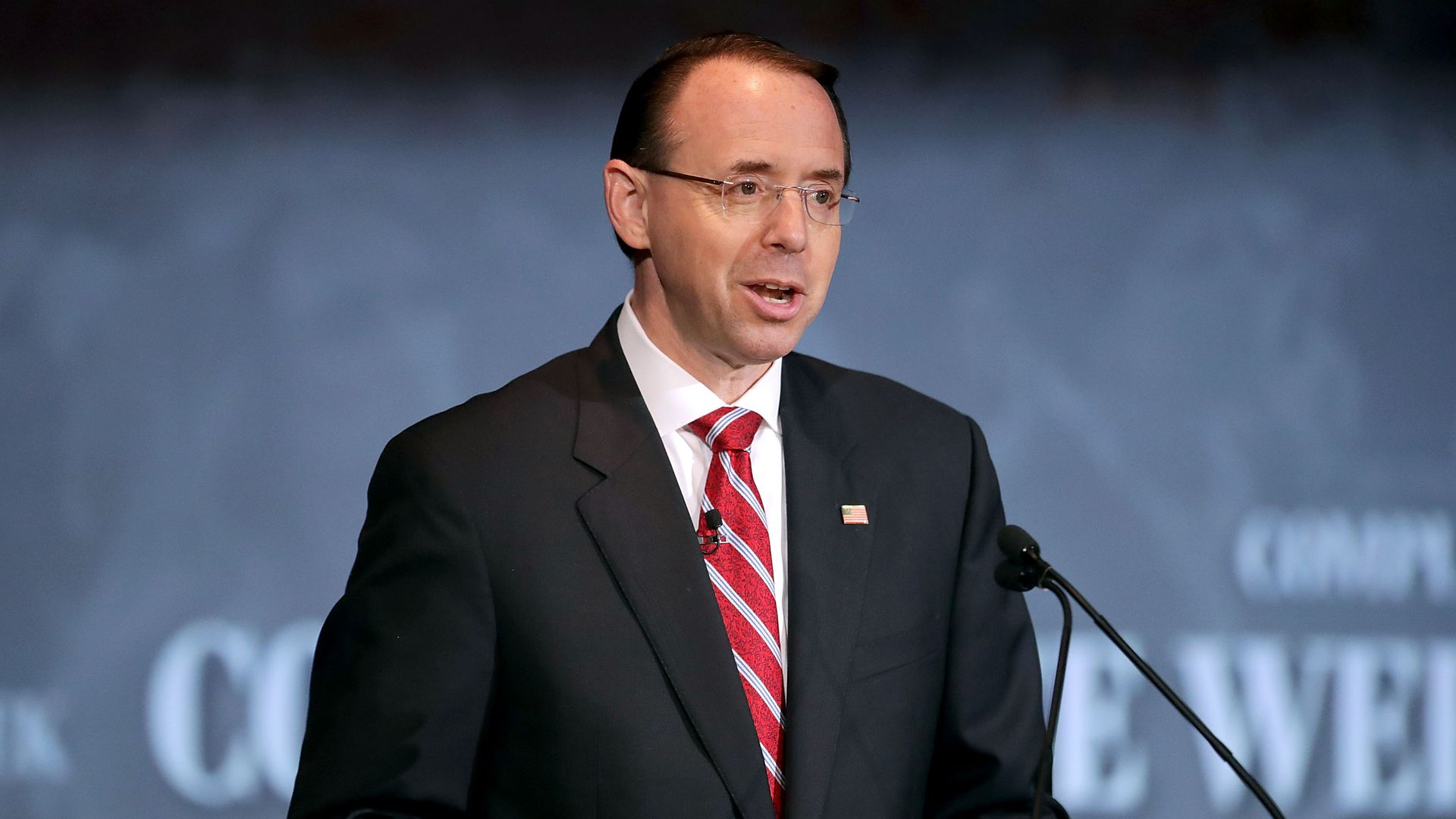 Rod Rosenstein speaks from behind a podium