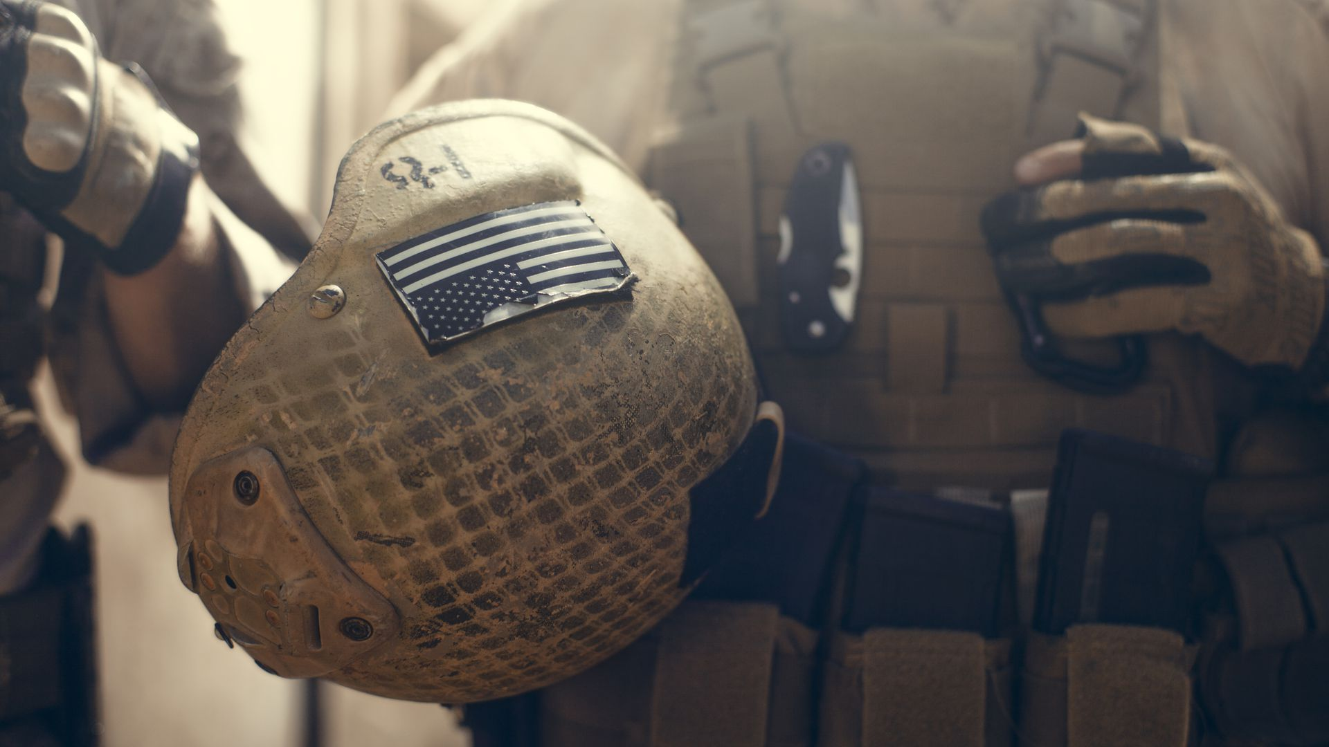 American soldier carrying their helmet