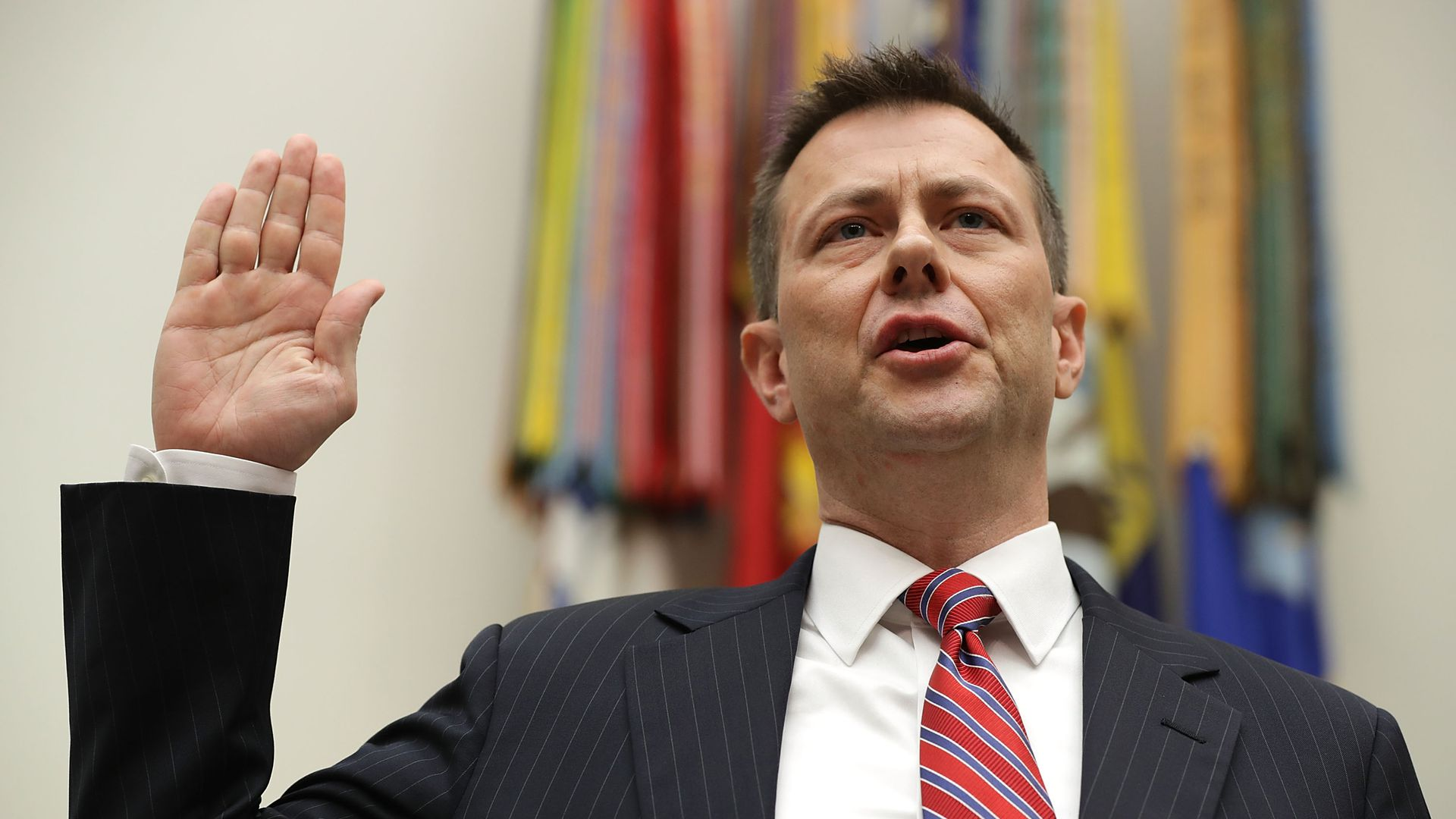 Strzok raises his hand to take an oath