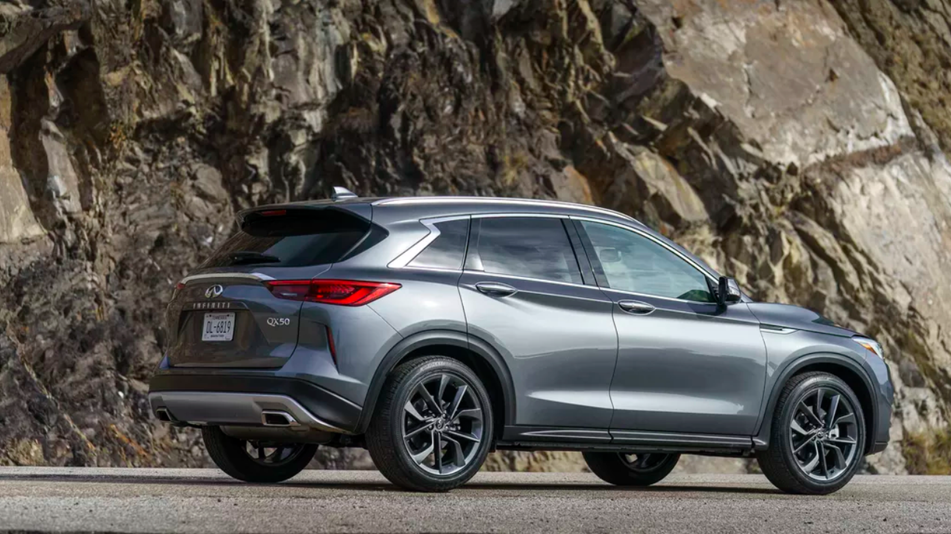 In this image, the Infiniti Qx50 is seen while driving on a mountainous pass.