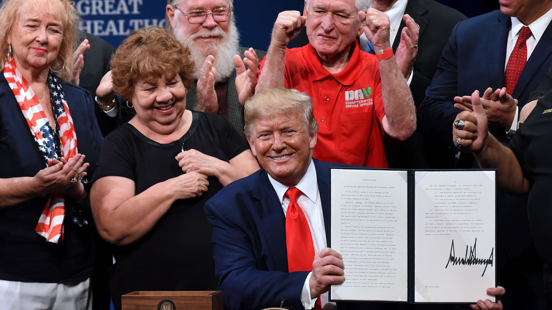 President Donald Trump signs an executive order to protect and improve Medicare