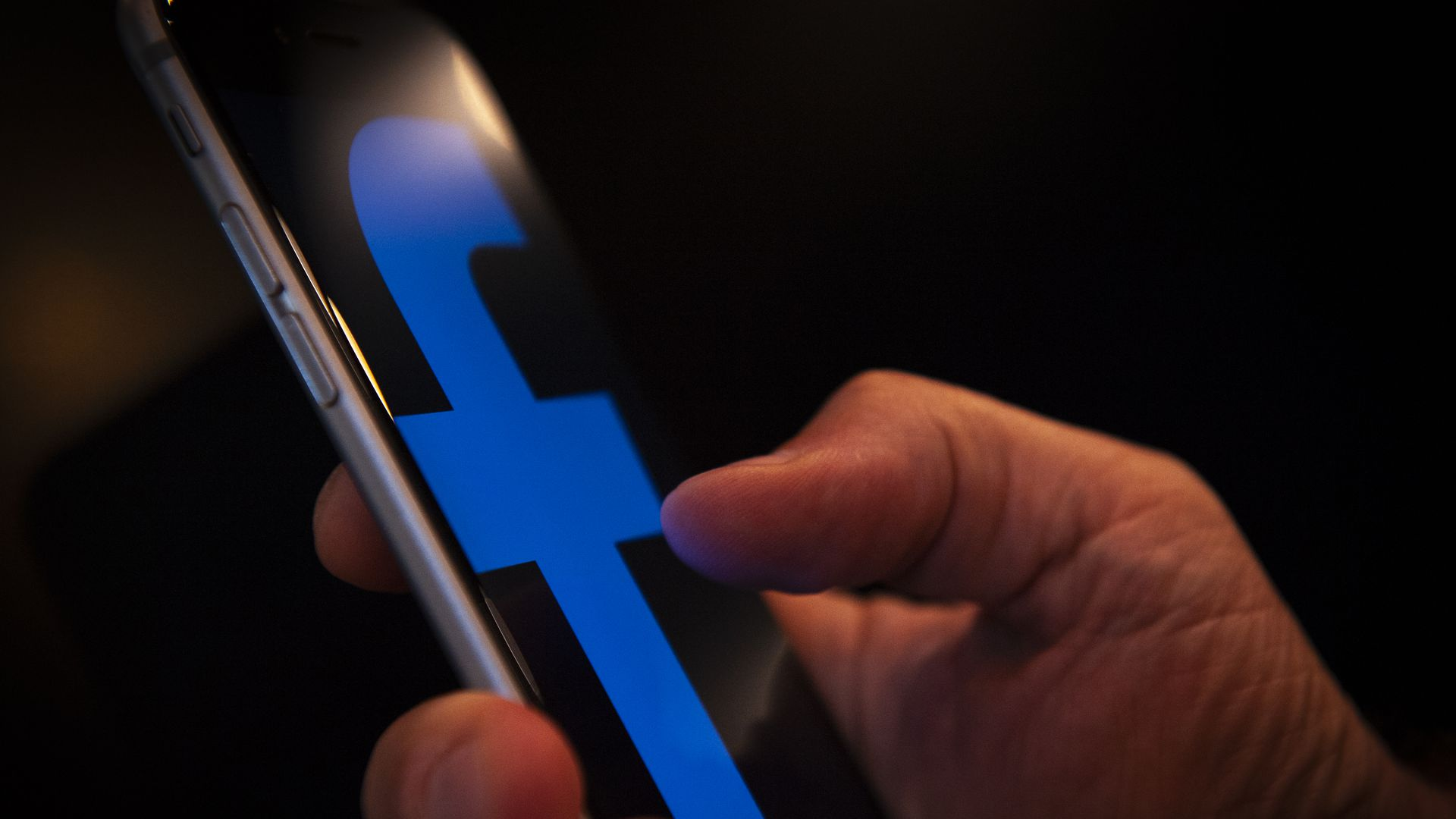 A Facebook logo is seen on an iPhone is seen in this photo illustration on July 9, 2018. (Photo by Jaap Arriens/NurPhoto via Getty Images)