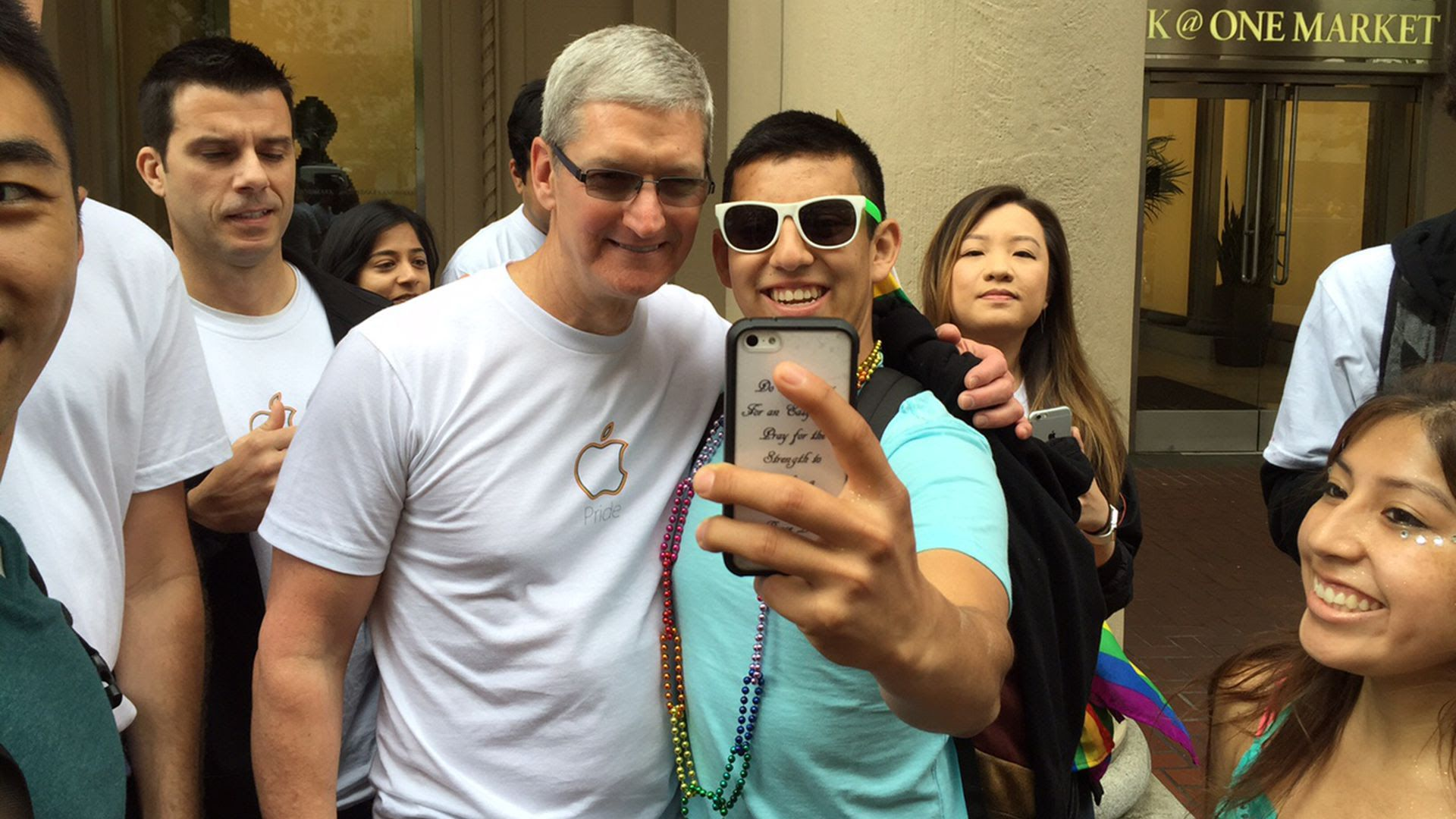 Apple CEO Tim Cook poses for a selfie with a group of teenagers