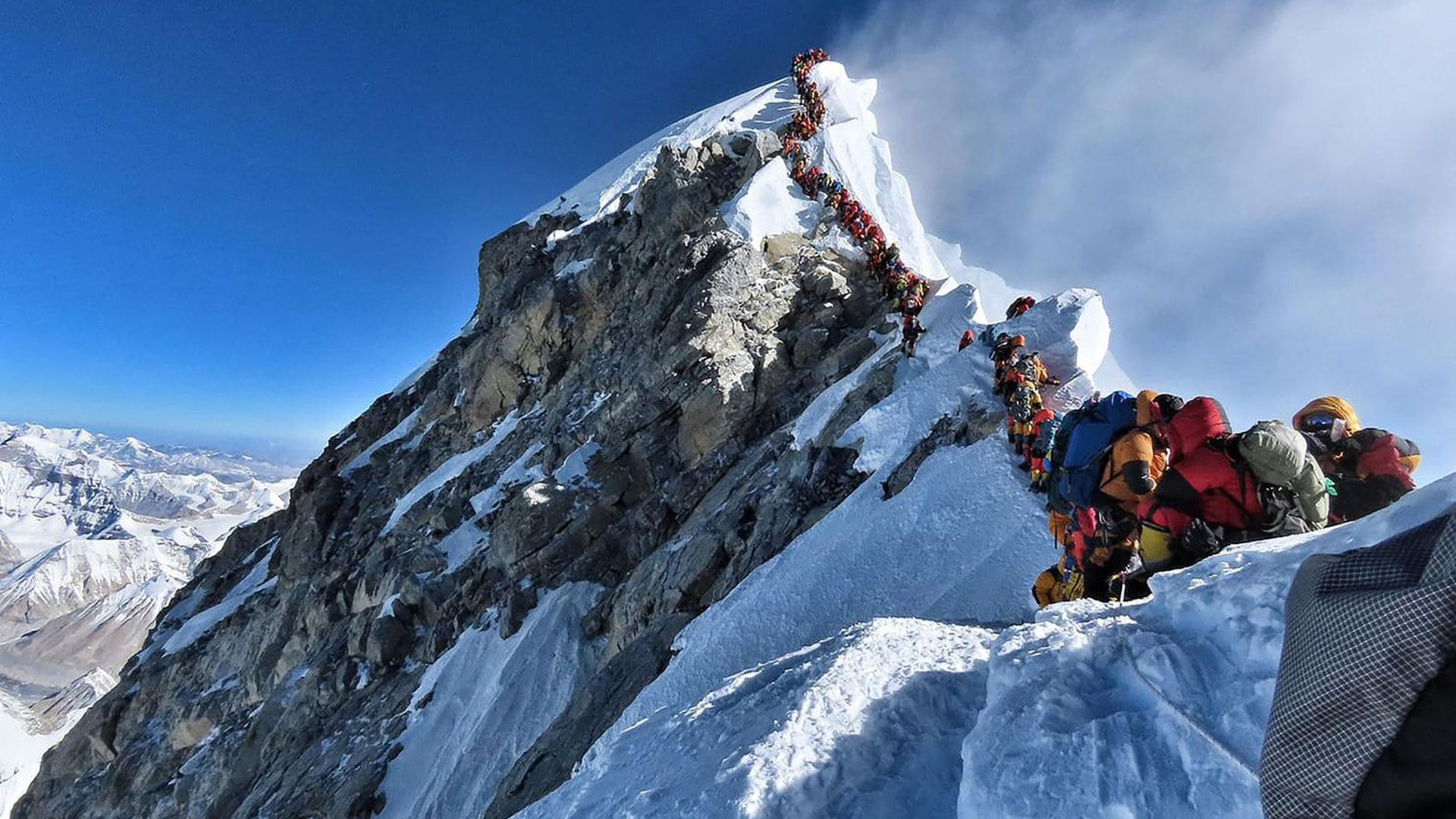 Mountain climbers line up to stand at Mount Everest's summit on May 22. (Nirmal Purja/Project Possible/AFP/Getty Images)