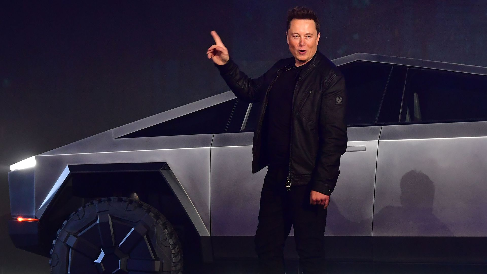 Tesla co-founder and CEO Elon Musk gestures while introducing the newly unveiled all-electric battery-powered Tesla Cybertruck