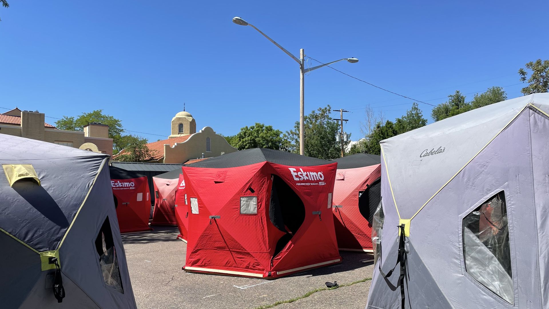 A photo of insulated tents lined up on a church parking lot in Denver's Park Hill neighborhood.
