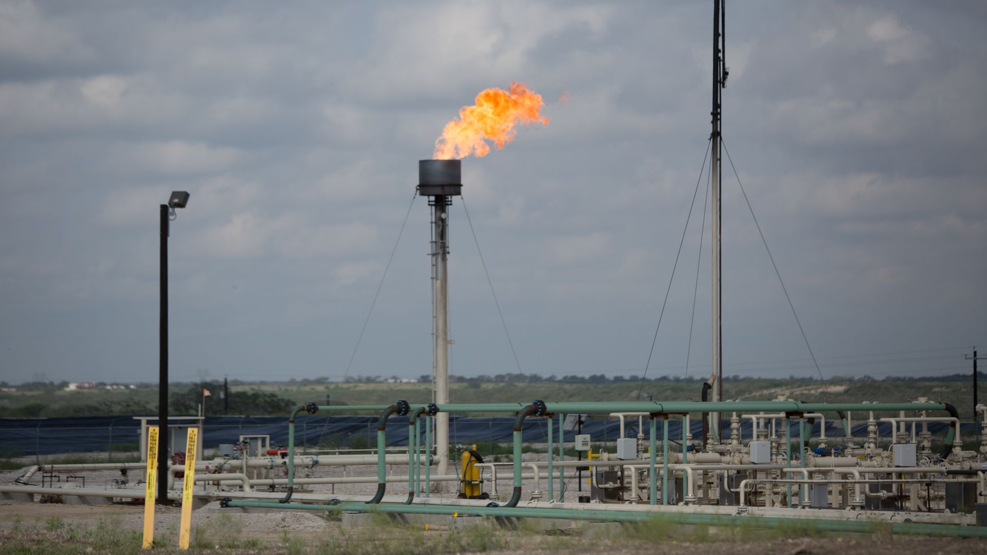 Flaring gas at a hyrdrolic fraturing site in Texas.
