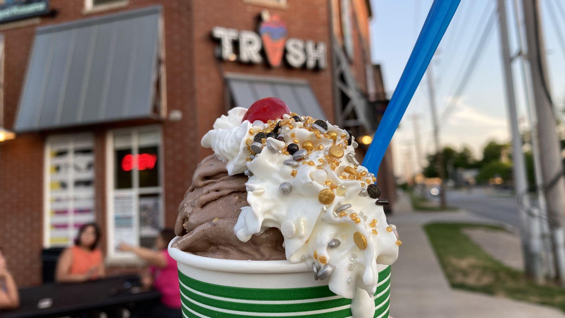 An ice cream sundae with whipped cream on top