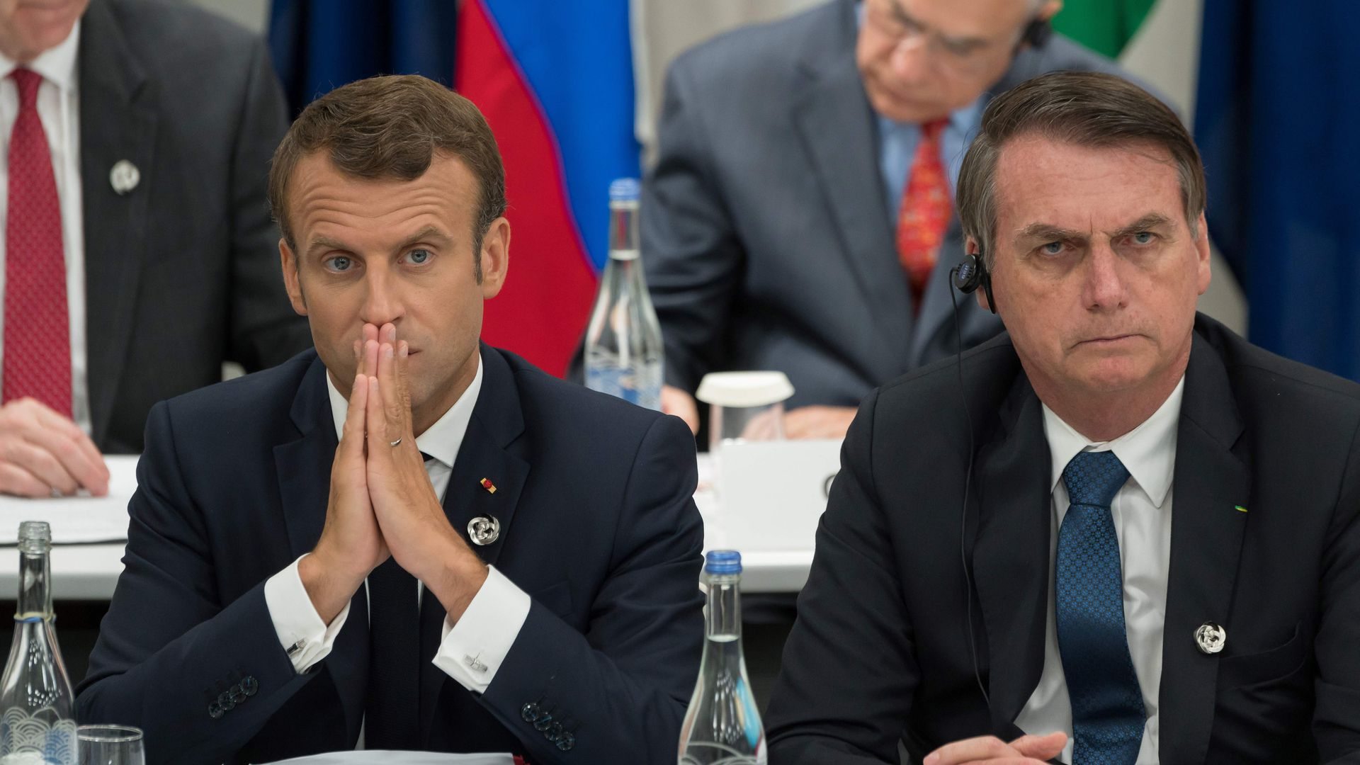 France's President Emmanuel Macron (L) and Brazil's President Jair Bolsonaro attend a meeting on the digital economy at the G20 Summit in Osaka on June 28, 2019.