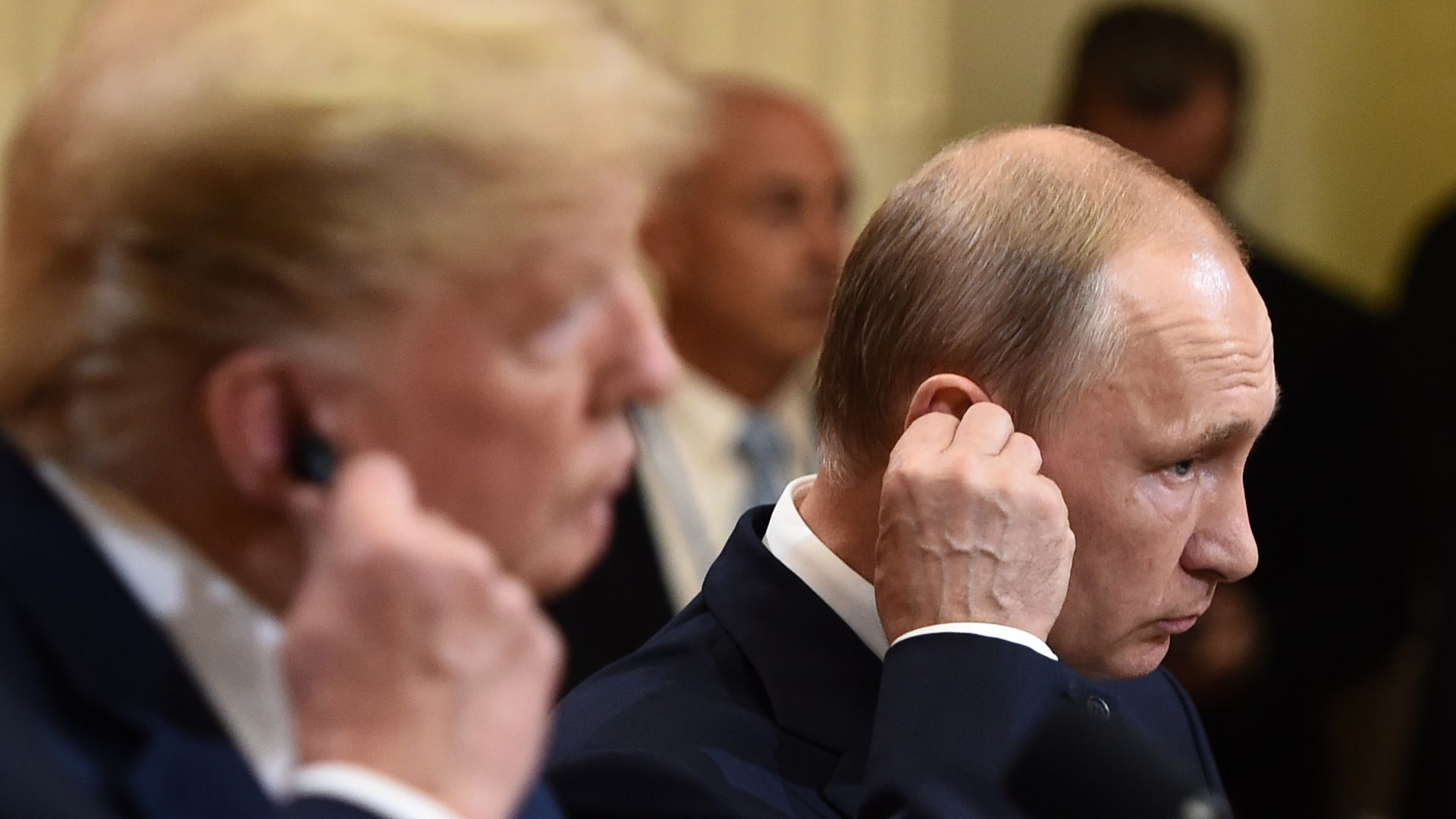 President Donald Trump and Russia's President Vladimir sitting next to each other at a press conference