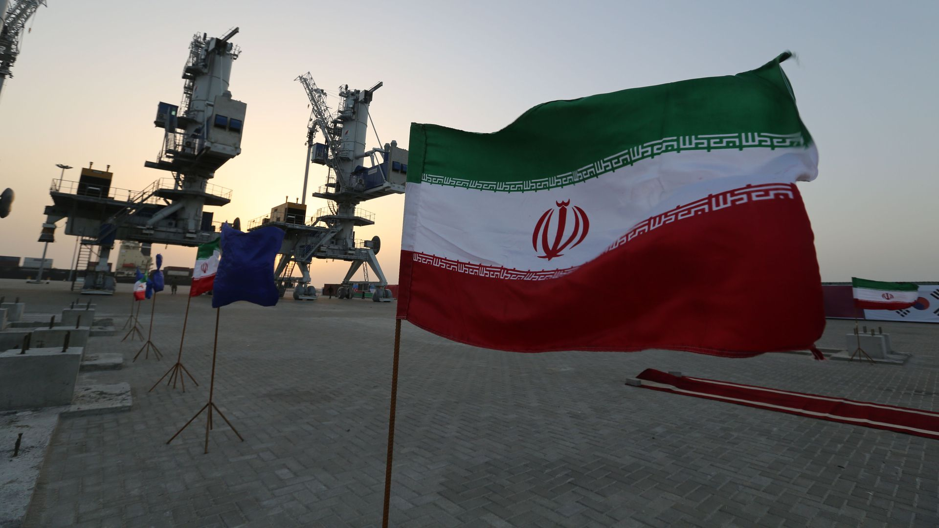 In this image, the Iranian flag flies in an oil field.