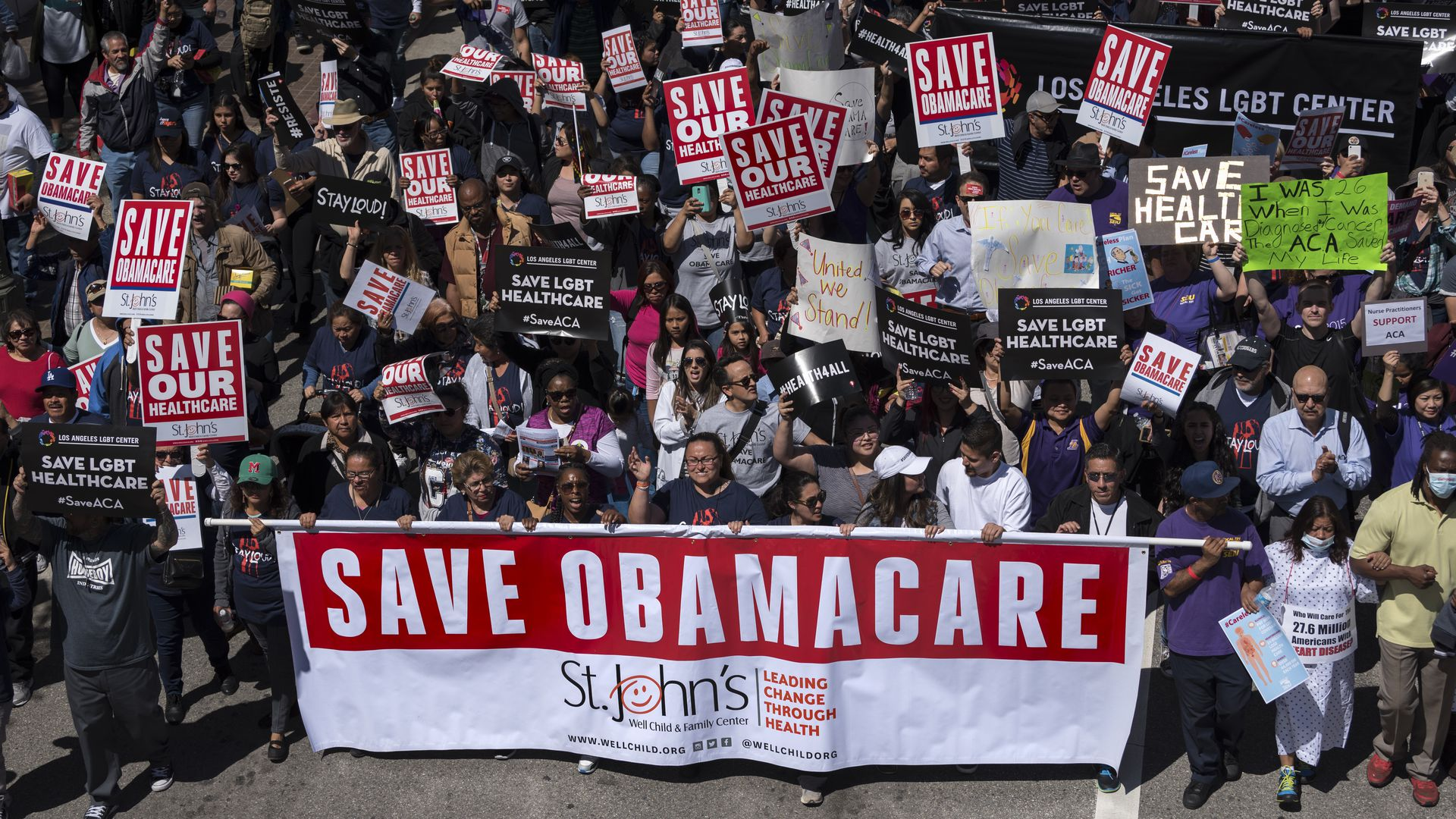 "Big Affordable Care Act rally in Los Angeles, with a ""Save Obamacare"" sign"
