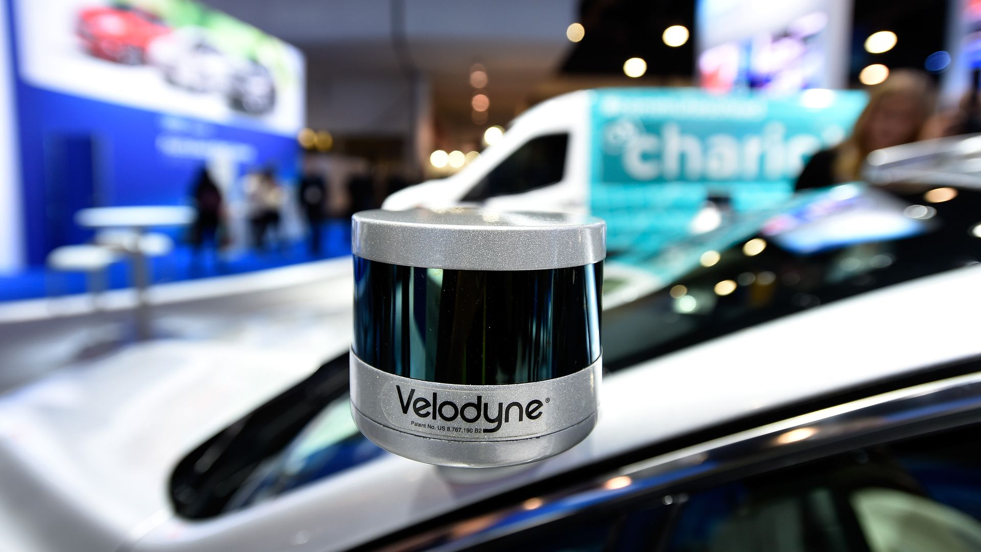 A Velodyne LiDAR sensor is mounted on a Ford Fusion hybrid